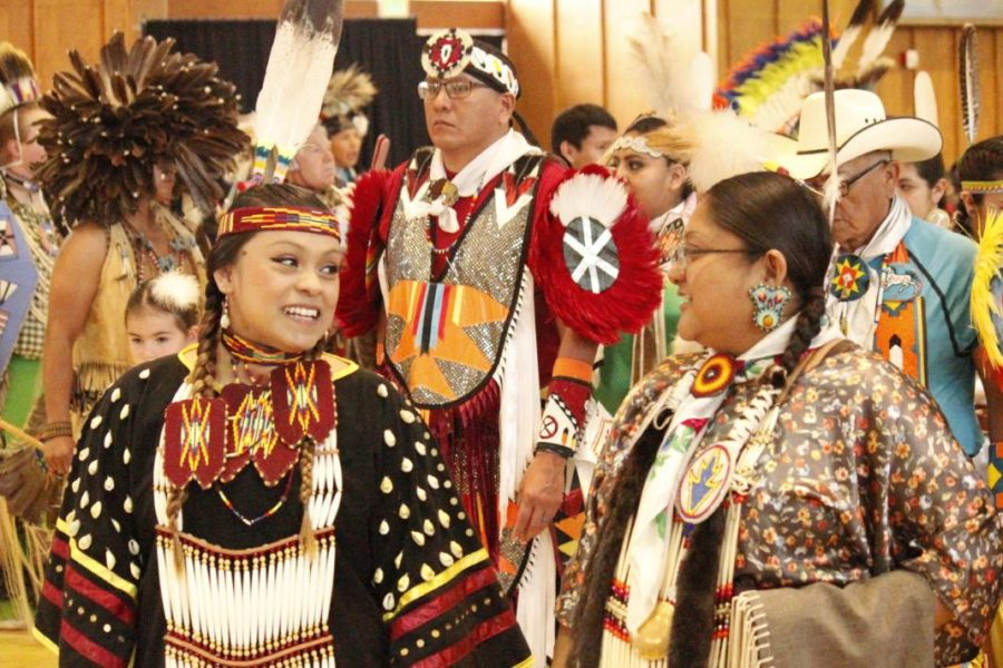 Women talk at the annual University of Utah Pow Wow on April 6 and 7, 2018. (Photo by Christina Giardinelli / The Daily Utah Chronicle)