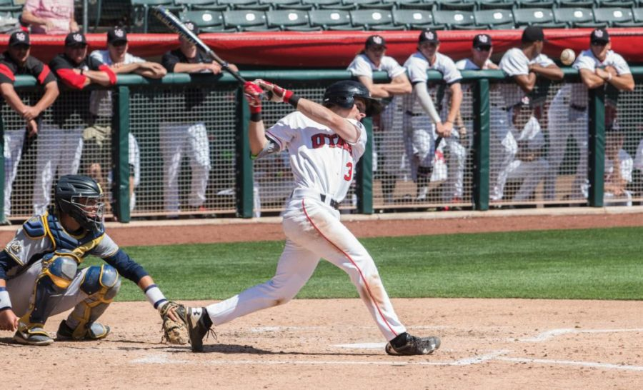 Sophomore Oliver Dunn cracks a single against Washington