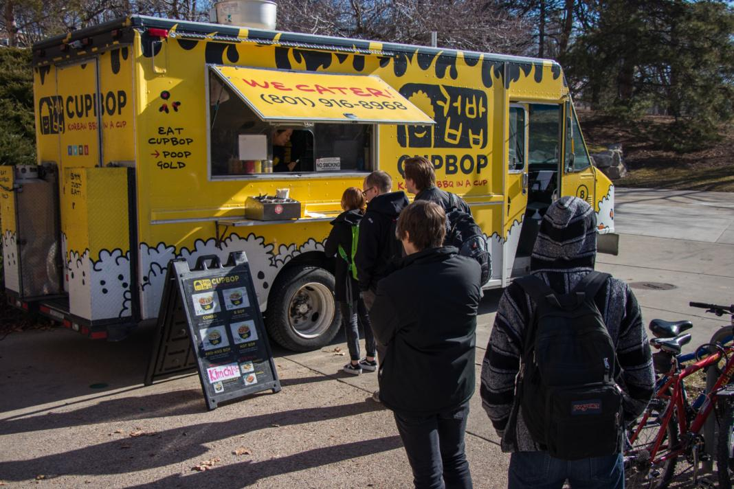 People line up in front of the Cupbop food truck during lunch on the University of Utah campus. (Photo by Justin Prather | The Daily Utah Chronicle)