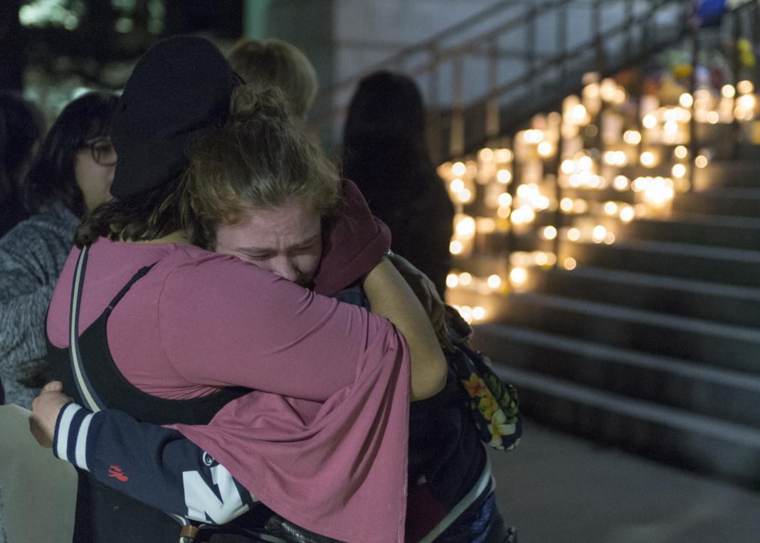 Students, staff, and friends of ChenWei Guo came to show their support after the recent shooting tragedy in Red Butte Canyon by lighting candles and walking from the Marriott Library to President's circle for a candle light vigil to share their condolences on Wednesday, Nov. 1, 2017  (Photo by Kiffer Creveling | The Daily Utah Chronicle)