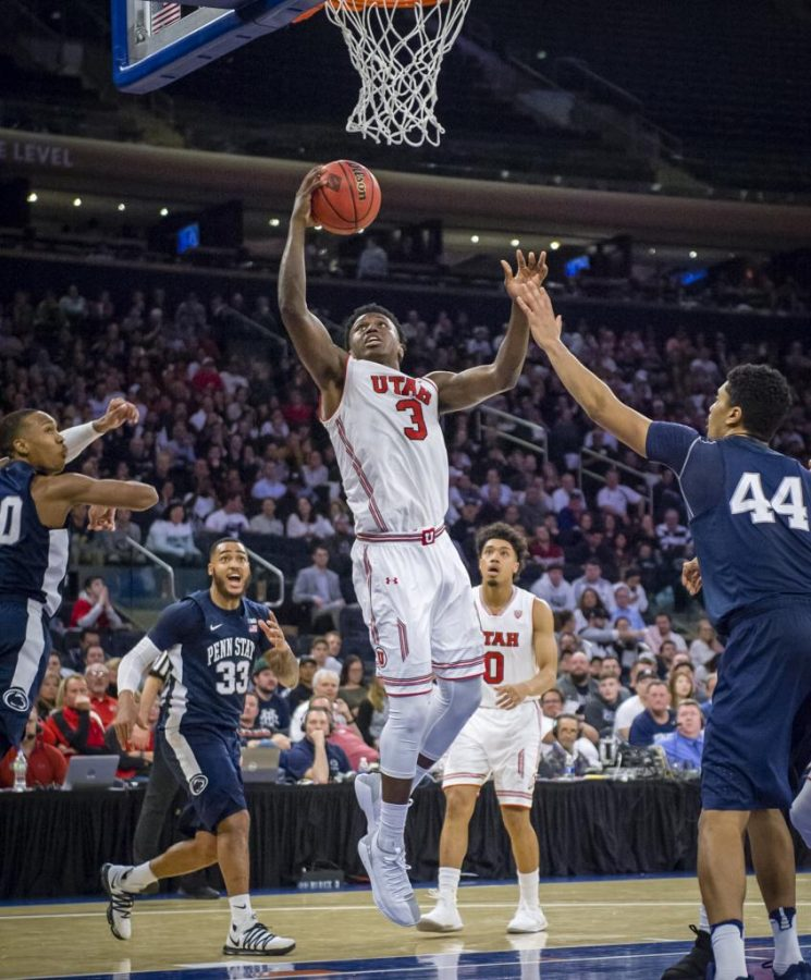Utah Utes forward Donnie Tillman (3) goes up for a one handed dunk as the University of Utah Running Utes take on the Penn State Nittany Lions in the championship game of the 2018 NIT at Madison Square Garden in New York City on March, 30 2018.