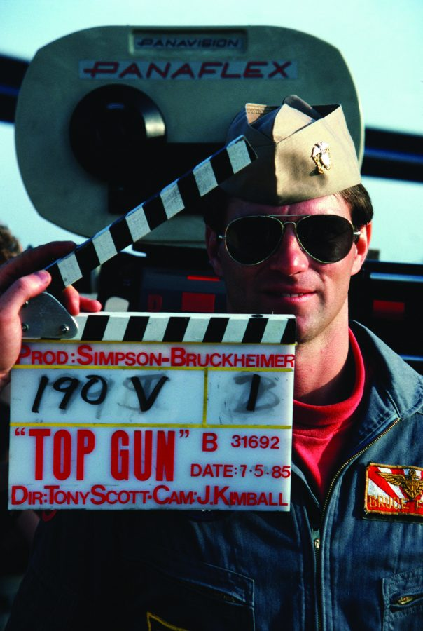 A naval aviator assists film makers in the production of the motion picture  Top Gun. (Courtesy of Wikimedia Commons)