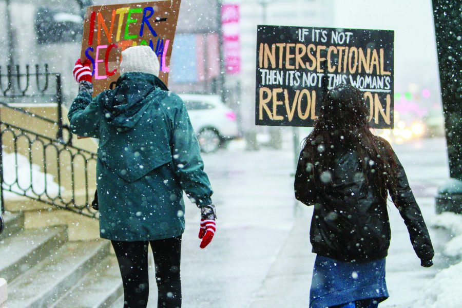 After the Womens march on the capital two women walk back down state street to a orchestra of bleeting horns showing support. January 23, 2017. Michael Adam Fondren for the Utah Daily Chronicle.