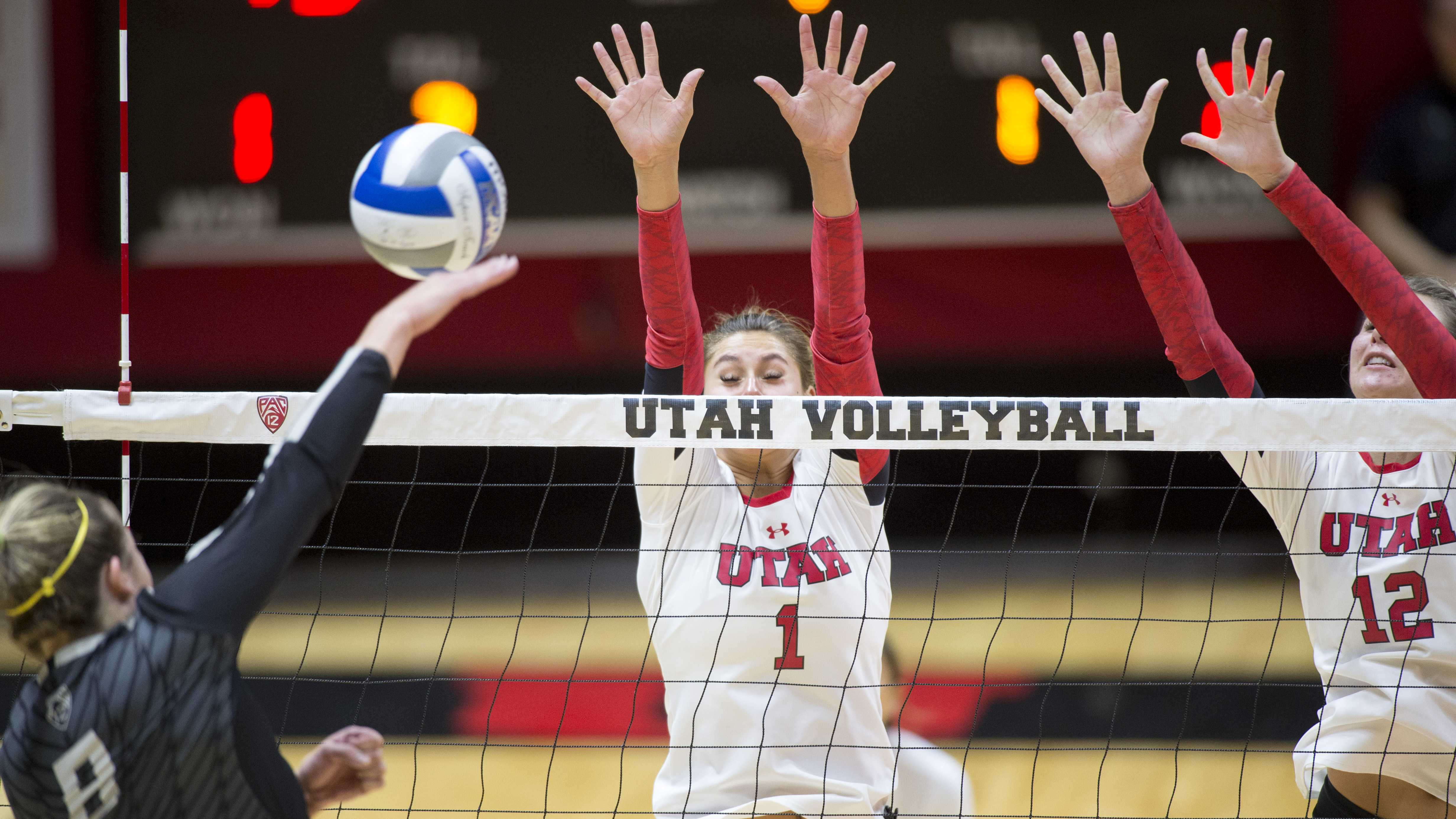 University of Utah Volleyball freshman outside hitter Dani Barton (1) and junior middle blocker Berkeley Oblad (12) leap to block a spike in a set of matches vs. The Oregon Ducks at the Huntsman Center in Salt Lake City, UT on Friday, Sept. 29, 2017  (Photo by Kiffer Creveling | The Daily Utah Chronicle)