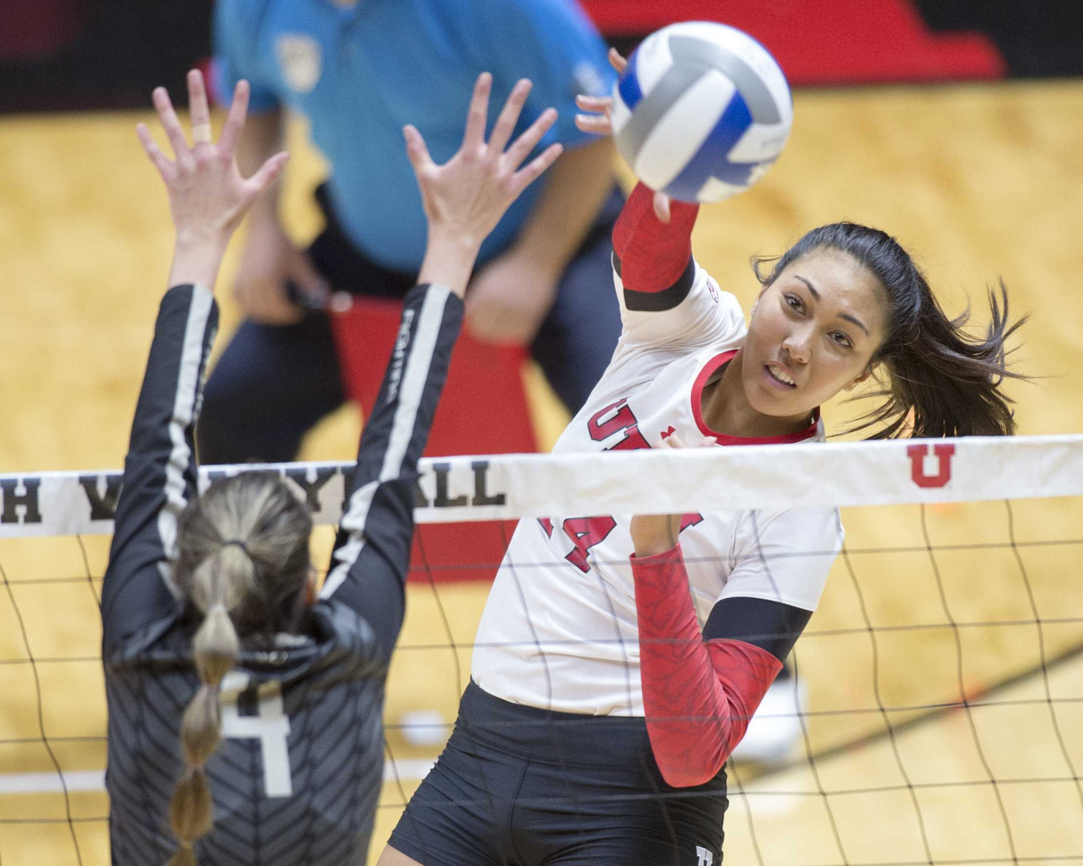 University of Utah Volleyball senior outside hitter Adora Anae (14) spikes the ball in a set of matches vs. The Oregon Ducks at the Huntsman Center in Salt Lake City, UT on Friday, Sept. 29, 2017  (Photo by Kiffer Creveling | The Daily Utah Chronicle)