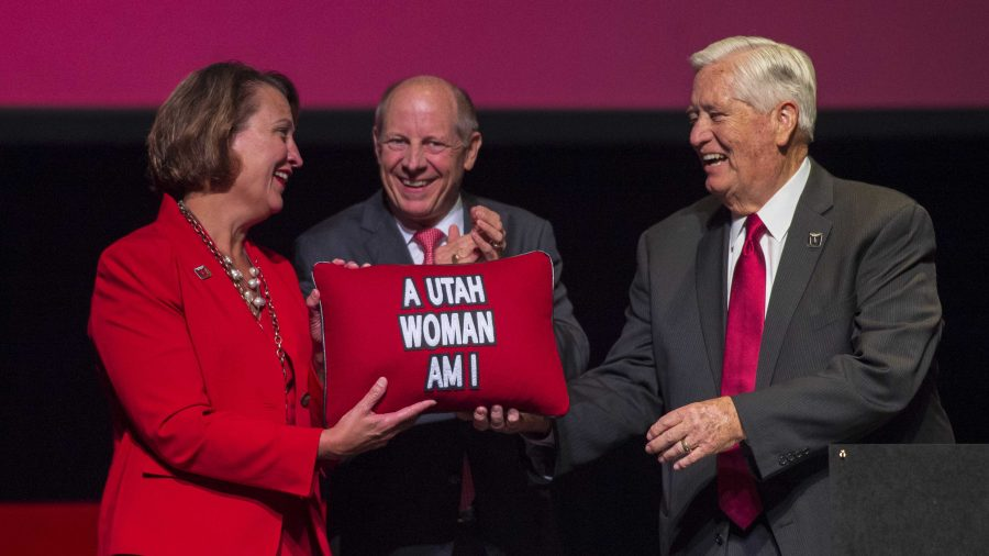 H. David Burton, chair of the University of Utah Board of Trustees (right), and Harris H. Simmons, chair of the Utah Board of Regents (center), present Dr. Ruth Watkins with a