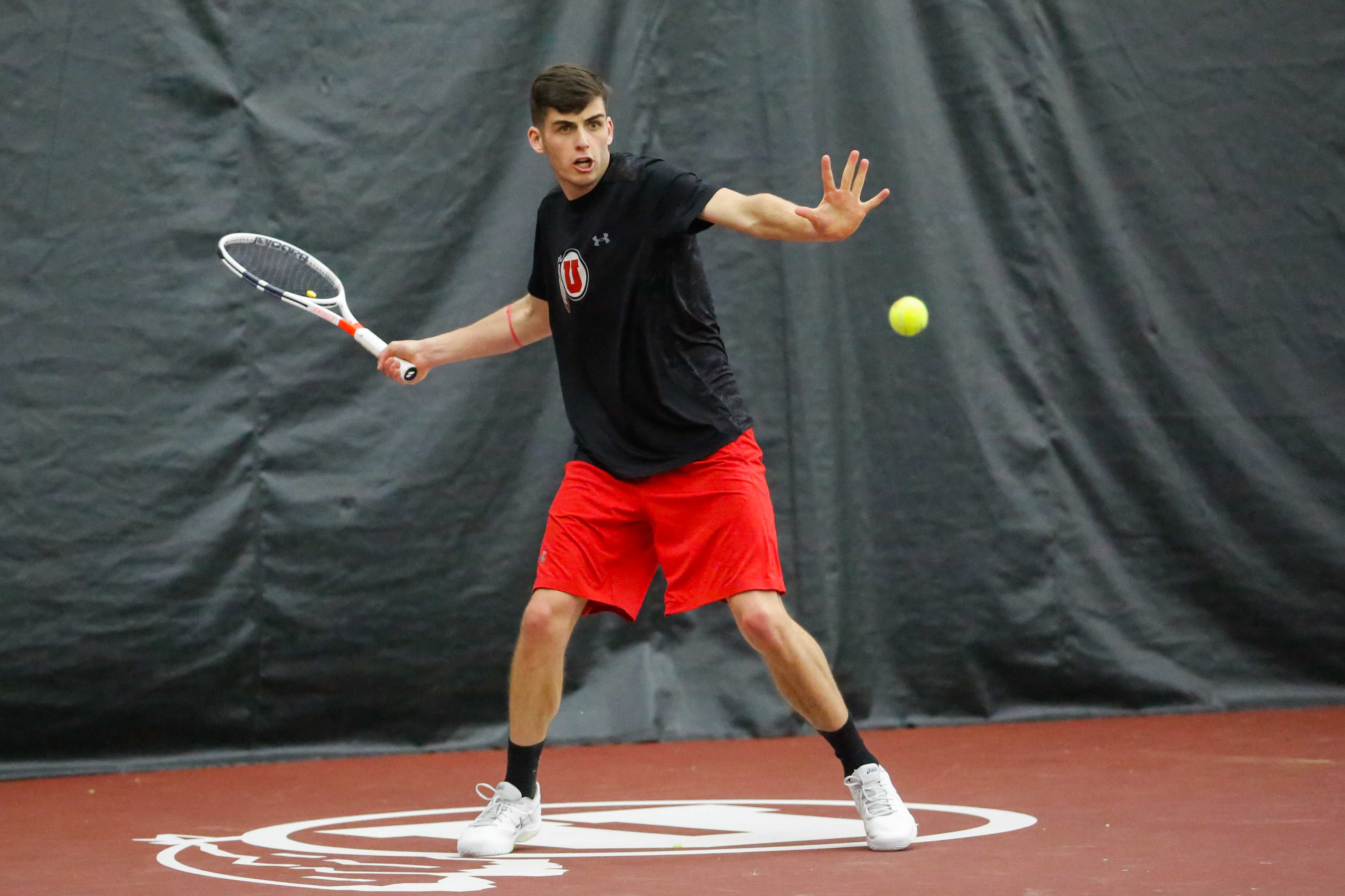 Dan Little returned the ball with a forehand as the  Utah Utes Men's Tennis team take on the Utah State Aggies at George S. Eccles Tennis Center in Salt Lake City, UT on Sunday, January 21, 2018.  (Photo by Curtis Lin/ Daily Utah Chronicle)