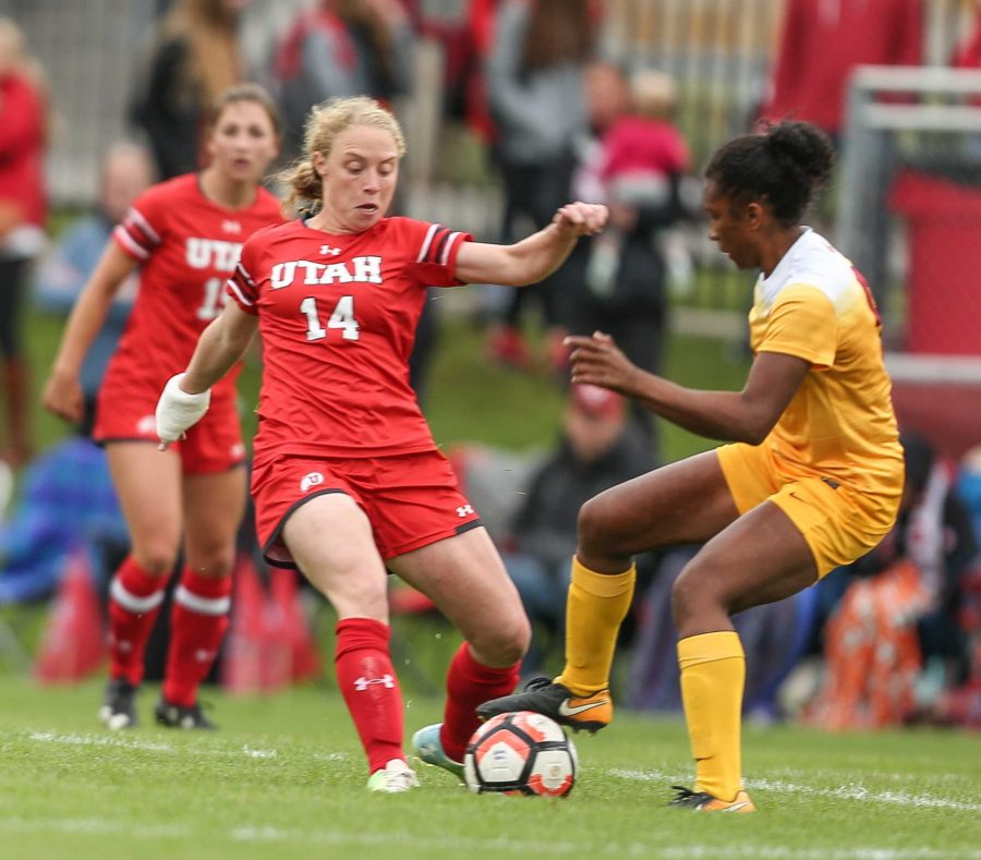 Paola Van Der Even (14) dribbles past a Trojan during the Utah Utes Womens soccer tie game versus University of Southern California at Ute Soccer Field in Salt Lake City, UT on Saturday, September 23, 2017.(Photo by Cassandra Palor/ Daily Utah Chronicle)