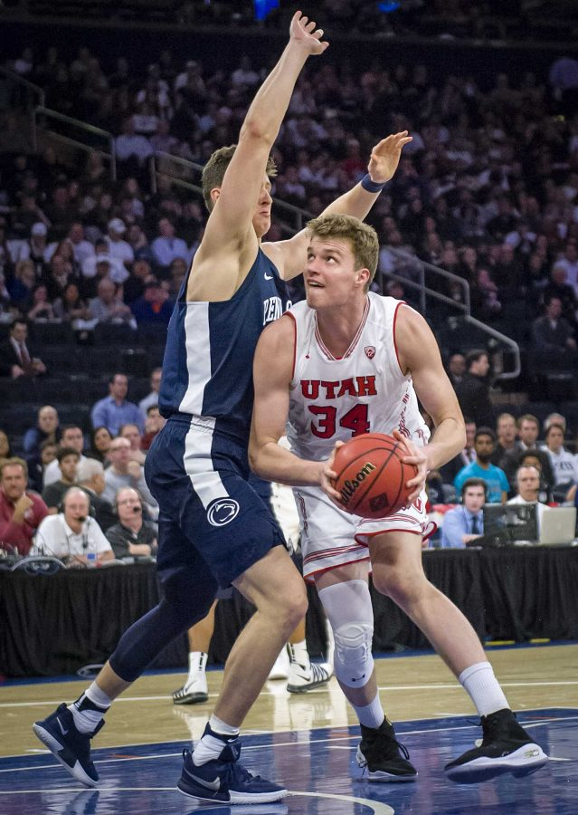 Utah Utes forward Jayce Johnson (34) ducks under the arm of Penn State Nittany Lions forward John Harrar (21) to try and take his shot as the University of Utah Running Utes take on the Penn State Nittany Lions in the championship game of the 2018 NIT at Madison Square Garden in New York City on March 30, 2018.