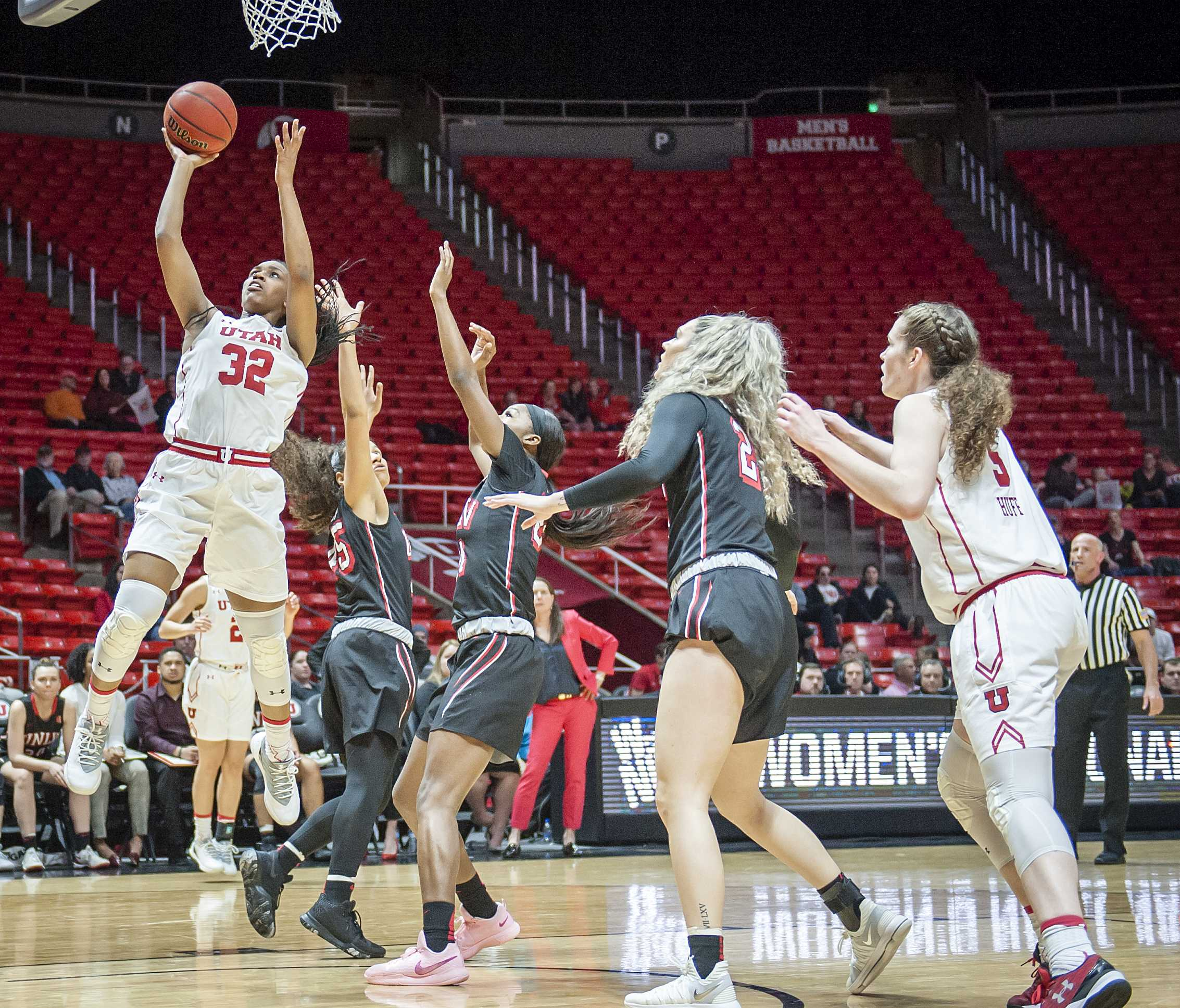 Utah Utes forward Tanaeya Boclair (32) shoots after driving through the UNLV defense as the University of Utah Lady Utes take on the UNLV Runin Rebels at the Huntsman Center in Salt Lake City, UT on Thursday, March 15, 2018.  (Photo by Adam Fondren | Daily Utah Chronicle)