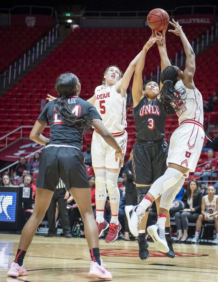 UNLV Rebels forward/center Paris Strawther (3) fights for a rebound with Utah Utes center Megan Huff (5) and forward Tanaeya Boclair (32) as the University of Utah Lady Utes take on the UNLV Runin Rebels at the Huntsman Center in Salt Lake City, UT on Thursday, March 15, 2018.  (Photo by Adam Fondren | Daily Utah Chronicle)