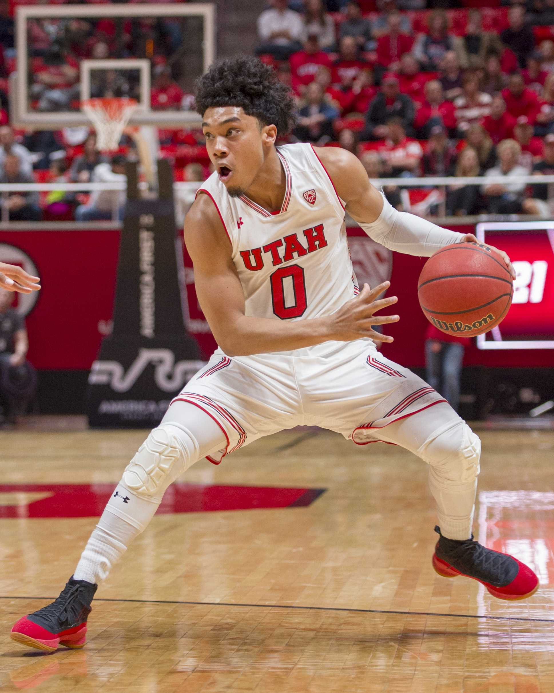 University of Utah junior guard Sedrick Barefield (0) dribbles the ball during an NCAA Basketball game vs. the University of Colorado Boulder at the Jon M. Huntsman Center in Salt Lake City, Utah on Saturday, March 3, 2018.  (Photo by Kiffer Creveling | The Daily Utah Chronicle)