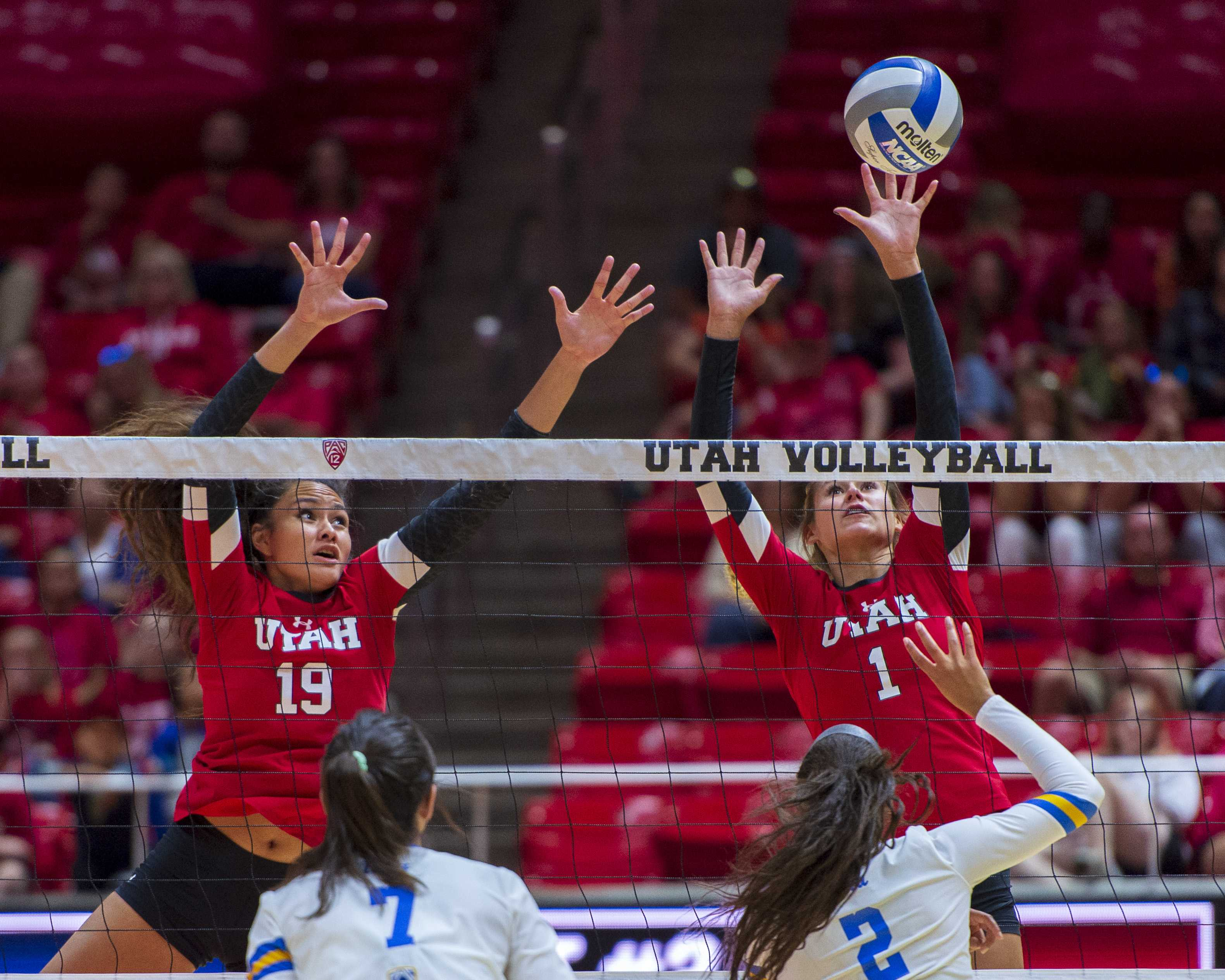 University of Utah sophomore outside hitter Dani Drews (1) blocks the shot along with Phoebe Grace (19) in an NCAA Volleyball match vs. the UCLA Bruins at the Jon M. Huntsman Center in Salt Lake City, Utah on Friday, Sept. 21, 2018. (Photo by Kiffer Creveling | The Daily Utah Chronicle)
