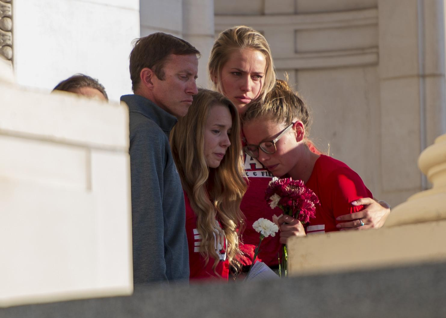 Students, staff, family and friends attend a vigil on the steps of the Park Building for Lauren McCluskey. Chronicle archives.