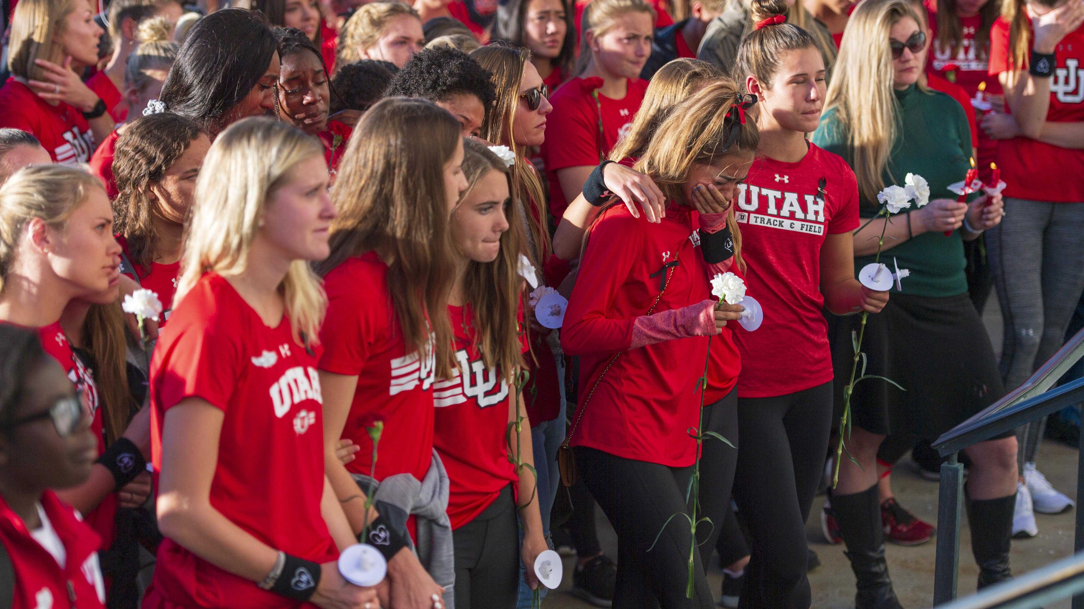 The Utah women's track and field team, students, staff, family and friends attend a vigil on the steps of the Park Building for Lauren McCluskey who was tragically killed on campus at The University of Utah in Salt Lake City, Utah on Wednesday, Oct. 24, 2018. (Photo by Kiffer Creveling | The Daily Utah Chronicle)