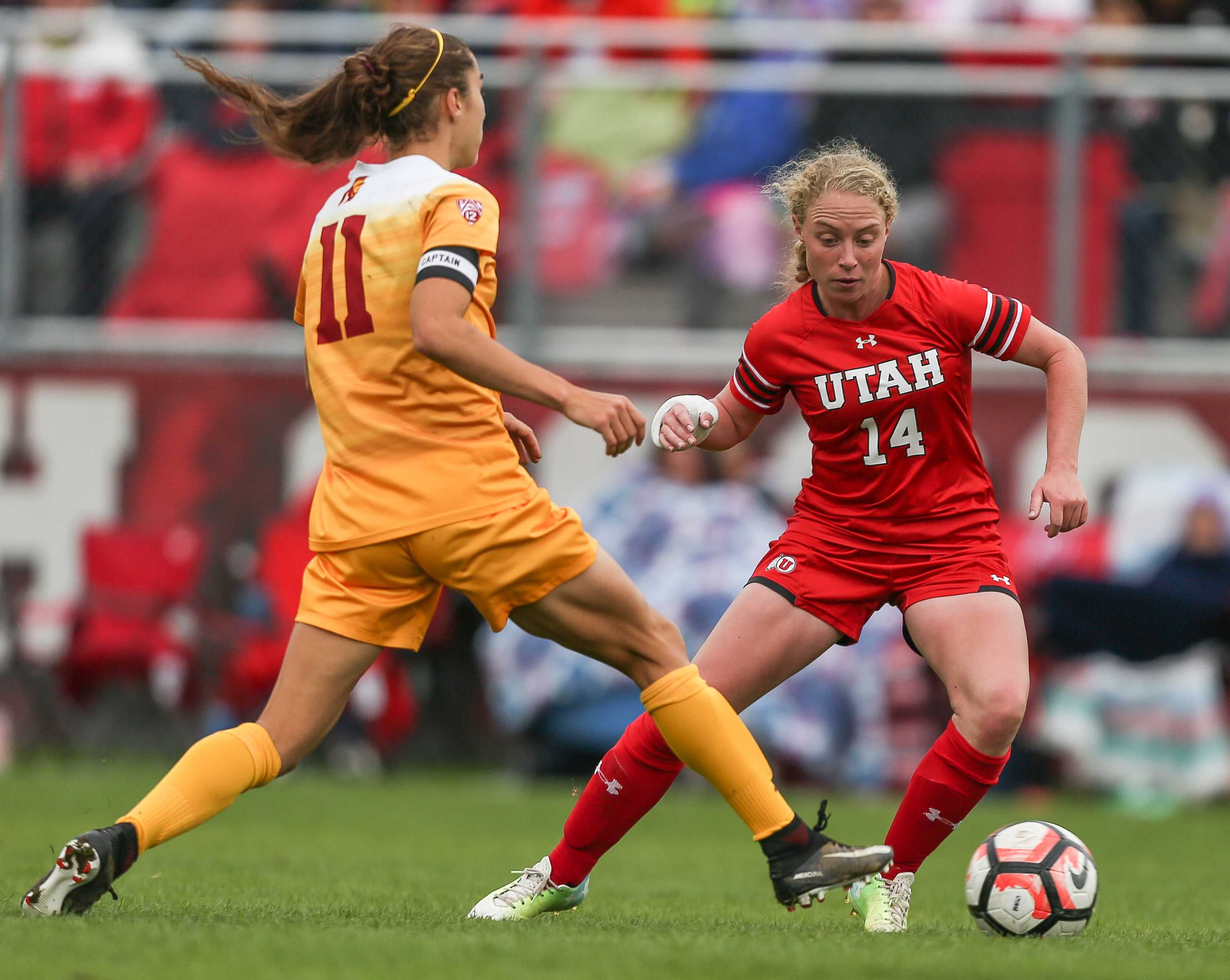 Paola Van Der Even (14) dribbles past Nicole Molen (11) during the Utah Utes Women's soccer tie game versus University of Southern California at Ute Soccer Field in Salt Lake City, UT on Saturday, September 23, 2017.  (Photo by Cassandra Palor/ Daily Utah Chronicle)