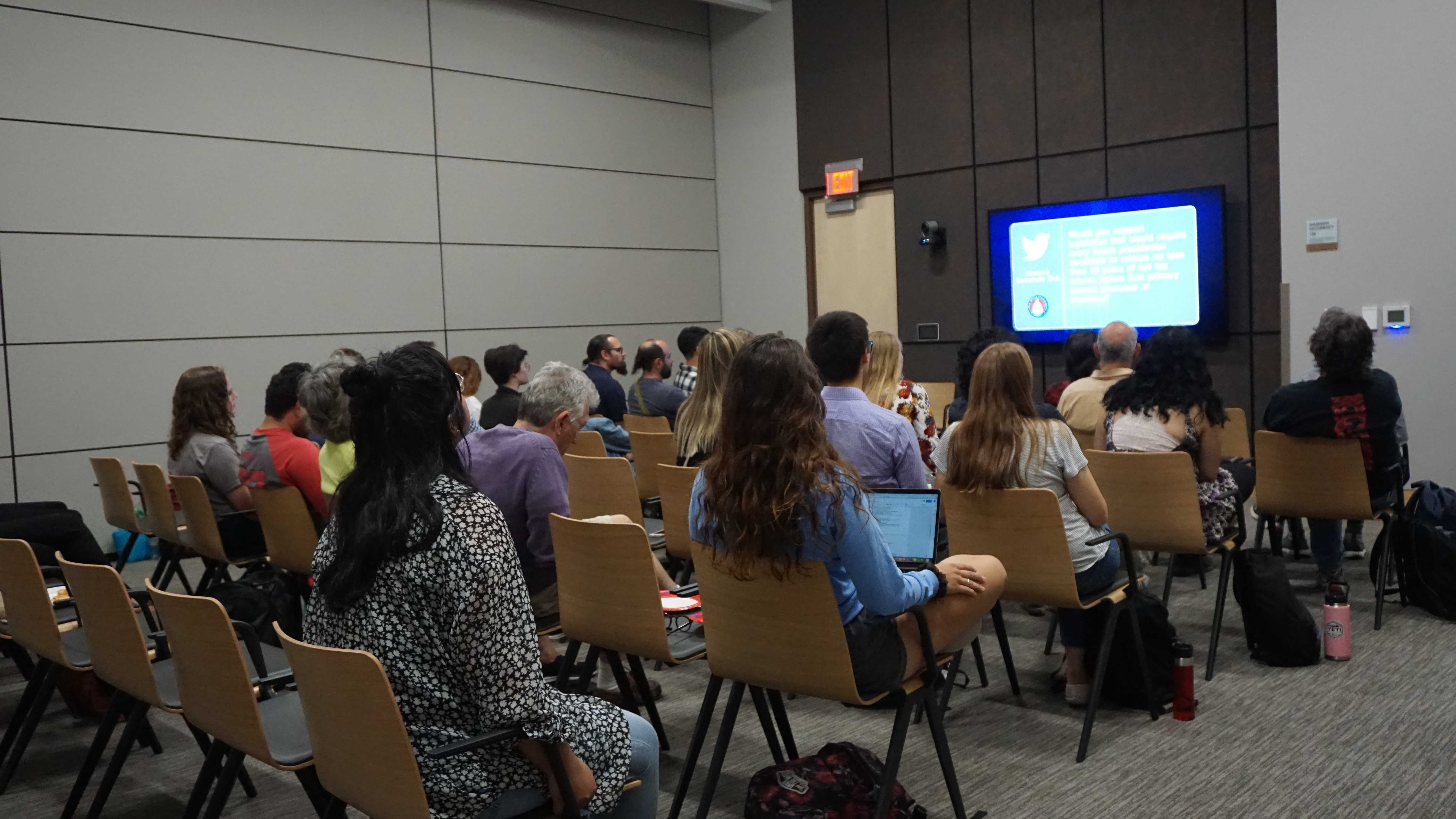 Students and community members watch a previous debate at the Hinckley Institute during the 2018 election season. Courtesy of Brooke Doner/Hinckley Institute.