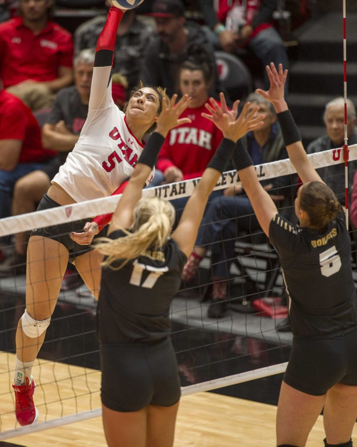 University+of+Utah+junior+outside+hitter+Lauga+Gauta+%285%29+spikes+the+ball+over+Purdue+redshirt+sophomore+middle+blocker+Blake+Mohler+%2817%29+and+redshirt+senior+setter+Ashley+Evans+%285%29+in+an+NCAA+Volleyball+match+vs.+The+Purdue+Boilermakers+at+the+Jon+M.+Huntsman+Center+in+Salt+Lake+City%2C+Utah+on+Friday%2C+Dec.+1%2C+2017%0A%0A%28Kiffer+Creveling+%7C+The+Daily+Utah+Chronicle%29