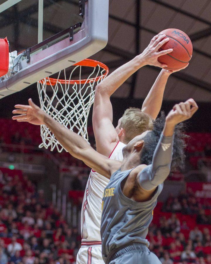 University of Utah senior forward Tyler Rawson (21) makes a slam dunk during an NCAA Basketball game vs. Arizona State University Sun Devils at the Jon M. Huntsman Center in Salt Lake City, Utah on Sunday, Jan. 7, 2018.  (Photo by Kiffer Creveling | The Daily Utah Chronicle)