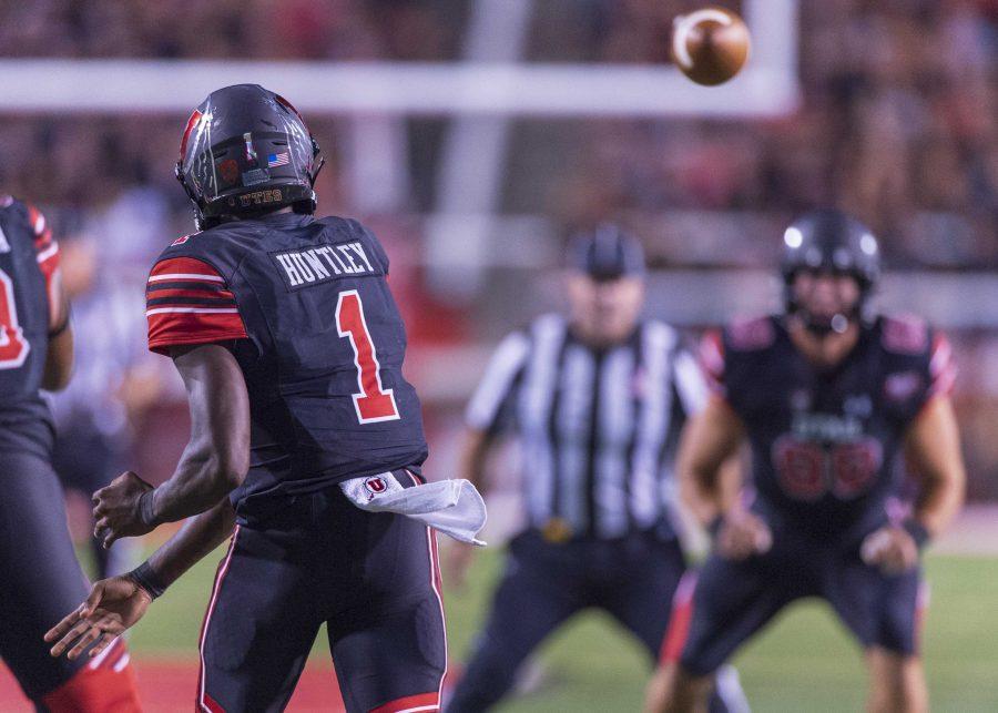 University of Utah junior quarterback Tyler Huntley (1) passes the ball to University of Utah freshman tight end Brant Kuithe (80) during an NCAA Football game at Rice Eccles Stadium in Salt Lake City, Utah on Saturday, Sept. 15, 2018. (Photo by Kiffer Creveling | The Daily Utah Chronicle)