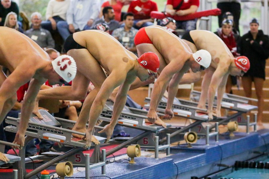 Sophomore Rahiti De Vos starting out of the blocks as the Utah Men and Womens Swim and Dive Team take on the Stanford Cardinals at the Ute Natatorium in Salt Lake City, UT on Friday, Oct. 20, 2017.  (Photo by Curtis Lin/ Daily Utah Chronicle)