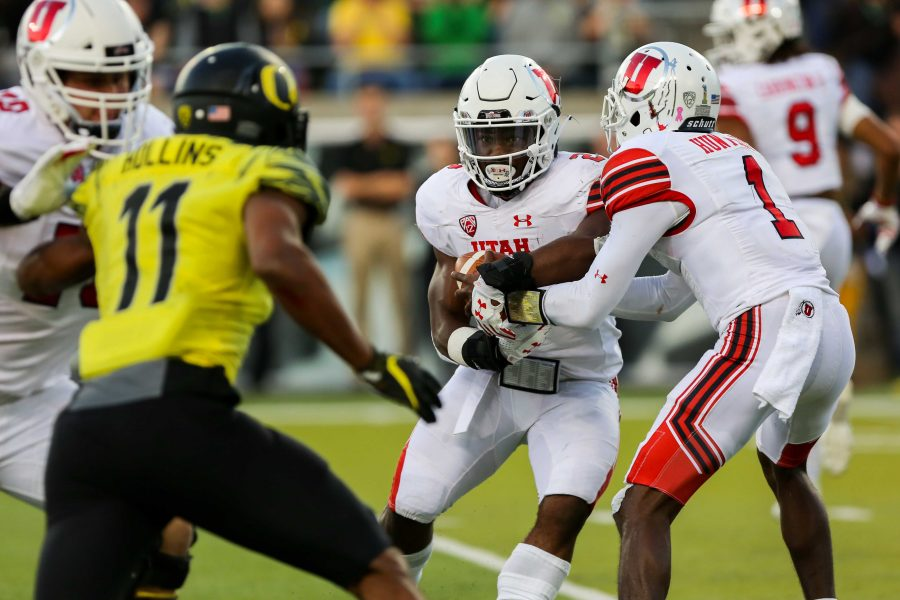 Sophomore quarterback Tyler Huntley (1) hands off the ball to sophomore running back Zack Moss (2) as the Utah Utes Football team take on the Oregon Ducks at Autzen Stadium in Eugene, OR on Saturday, October28, 2017.   (Photo by Curtis Lin/Daily Utah Chronicle)