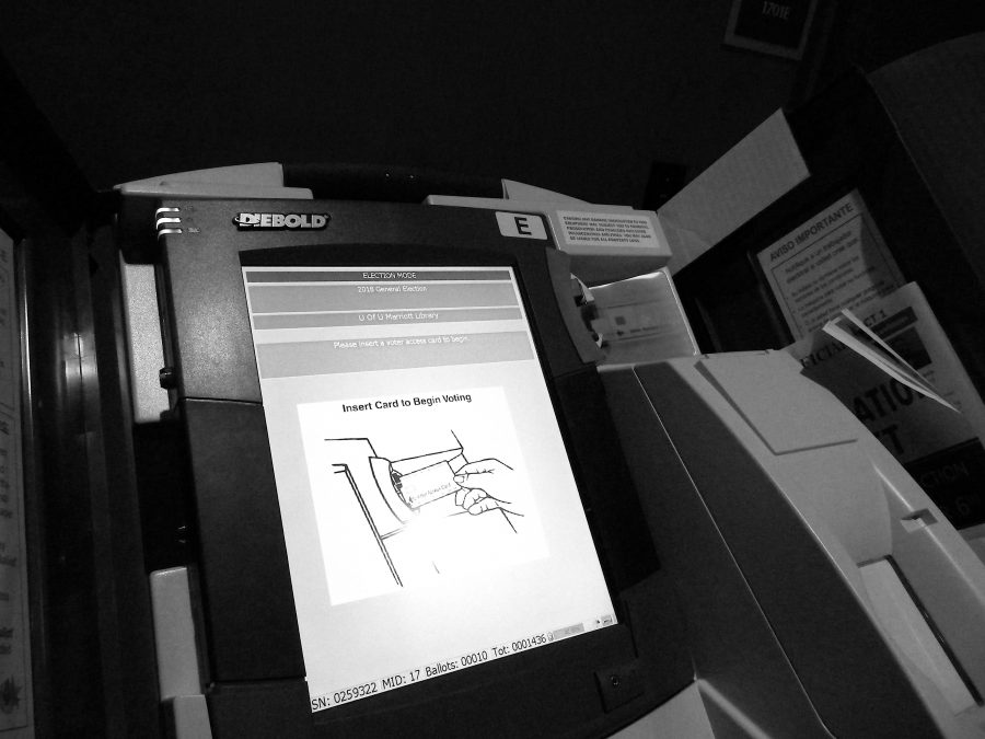 A+voting+machine+at+the+Marriott+Library.+Chronicle+archives.