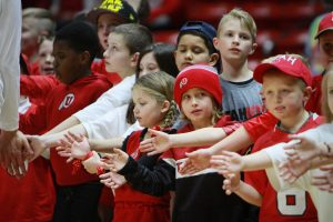 Kids wait to recieve high fives from the players during warm ups at the University of Utah Vs. Oregon State at the Huntsman Center January 28, 2017. Michael Adam Fondren for the Daily Utah Chronicle.