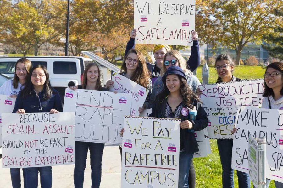Students 4 Choice holding their signs during the sexual assault protest in the MEB parking lot on Friday, Nov 4, 2016