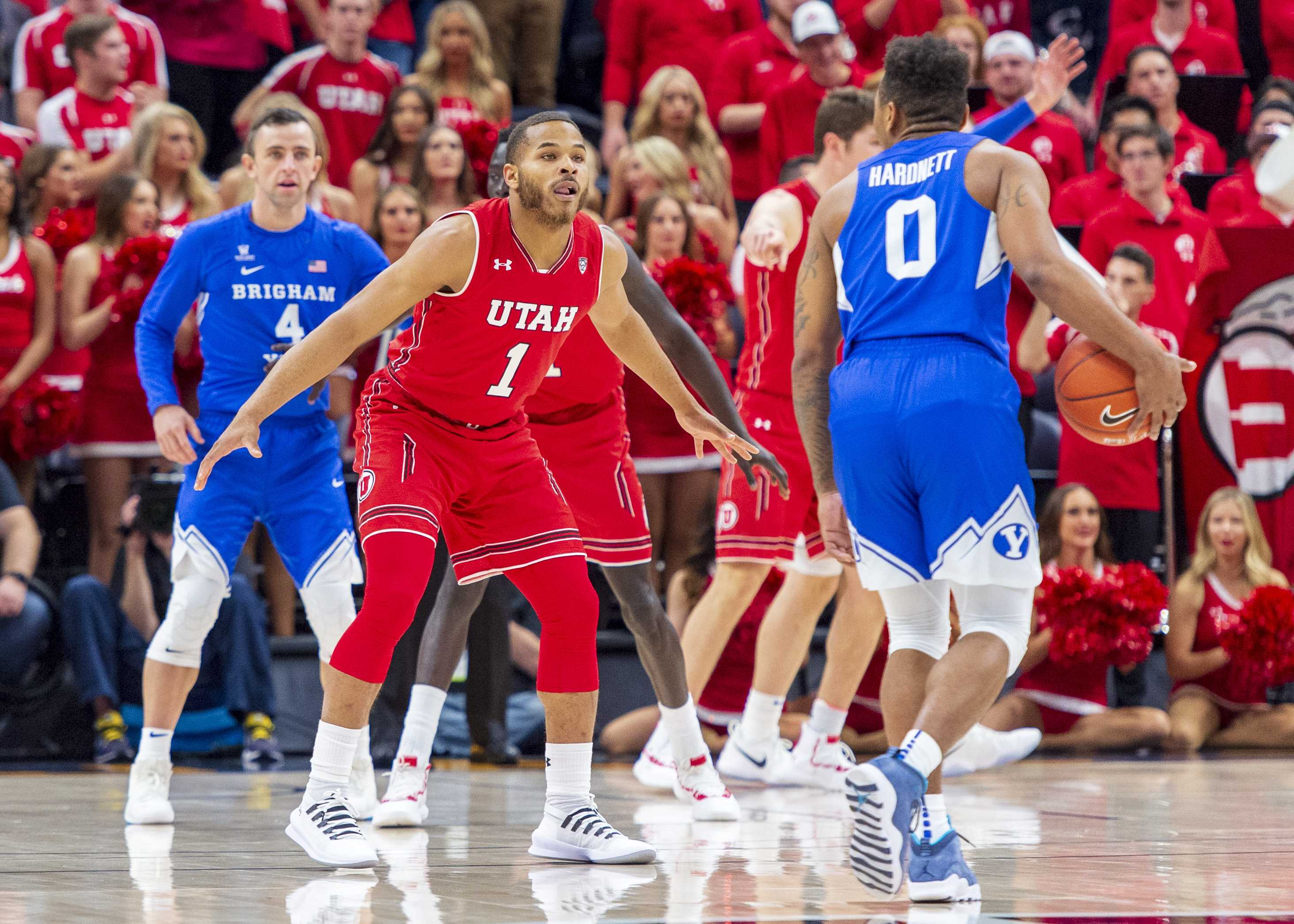 University of Utah junior guard Charles Jones (1) guards Brigham Young University junior guard Jahshire Hardnett (0) during an NCAA college basketball game at the Vivint Smart Home Arena in Salt Lake City, Utah on Saturday, Dec. 8, 2018. (Photo by Kiffer Creveling | The Daily Utah Chronicle)