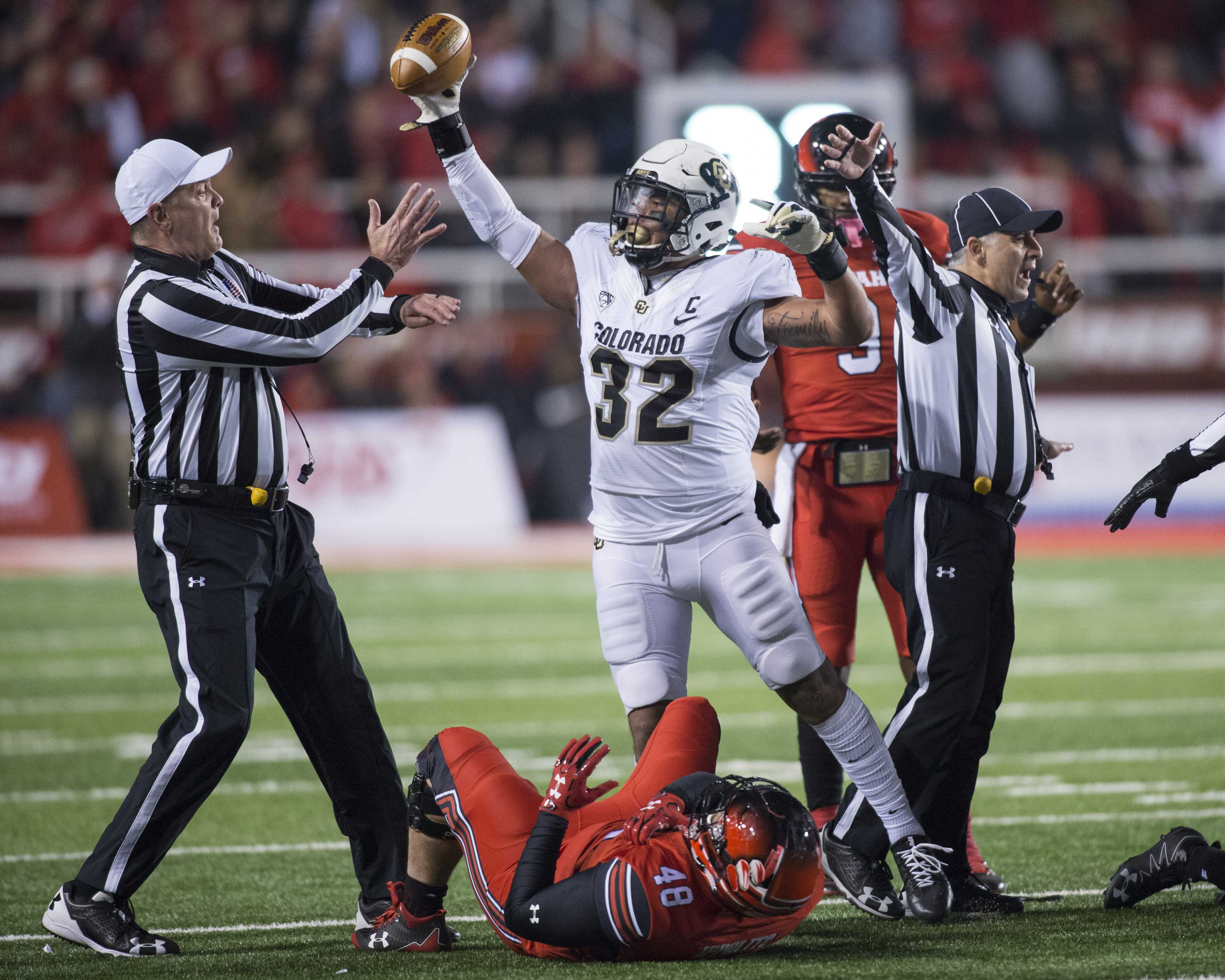 University of Colorado junior inside linebacker Rick Gamboa (32) celebrates a recovered fumble before the call was overturned by the referee during an NCAA Football game vs. The University of Utah Utes at Rice Eccles Stadium in Salt Lake City, Utah on Saturday, Nov. 25, 2017  (Photo by Kiffer Creveling | The Daily Utah Chronicle)