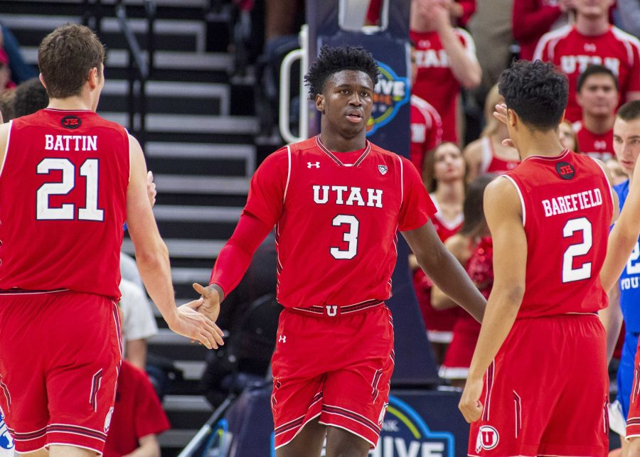 University of Utah sophomore forward Donnie Tillman (3)'s teammates congratulate him after his basket during an NCAA college basketball game vs. BYU at the Vivint Smart Home Arena in Salt Lake City, Utah on Saturday, Dec. 8, 2018. (Photo by Kiffer Creveling | The Daily Utah Chronicle)