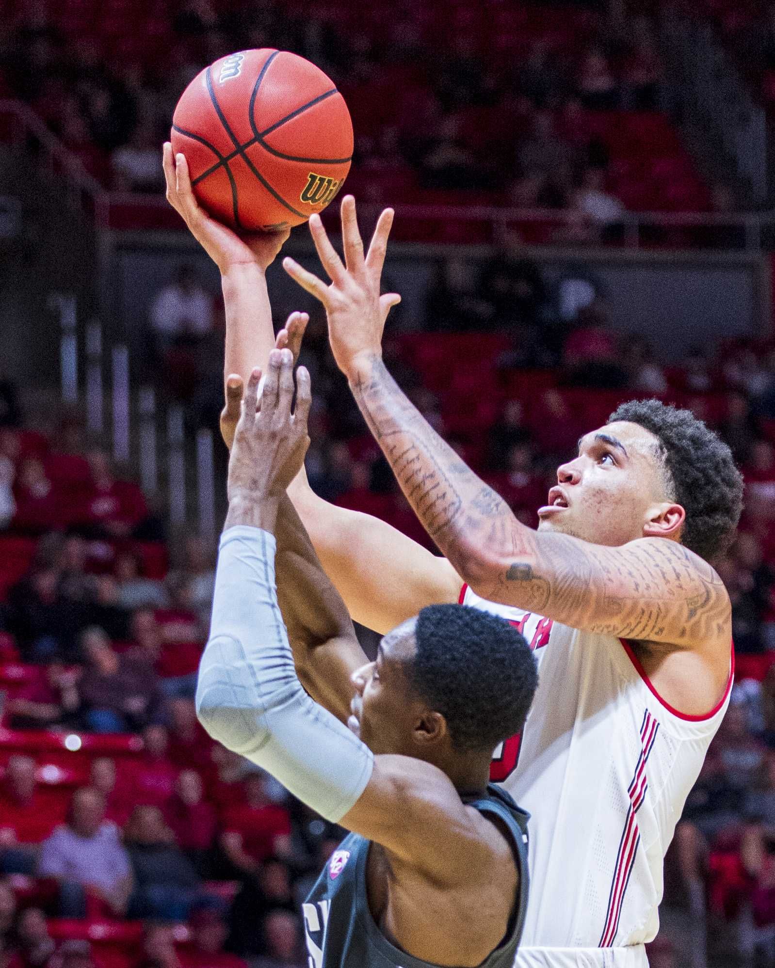 University of Utah freshman forward Timmy Allen (20) shoots over Washington State senior guard Viont'e Daniels (24) during an NCAA Basketball game at the Jon M. Huntsman Center in Salt Lake City, Utah on Saturday, Jan. 12, 2019. (Photo by Kiffer Creveling | The Daily Utah Chronicle)