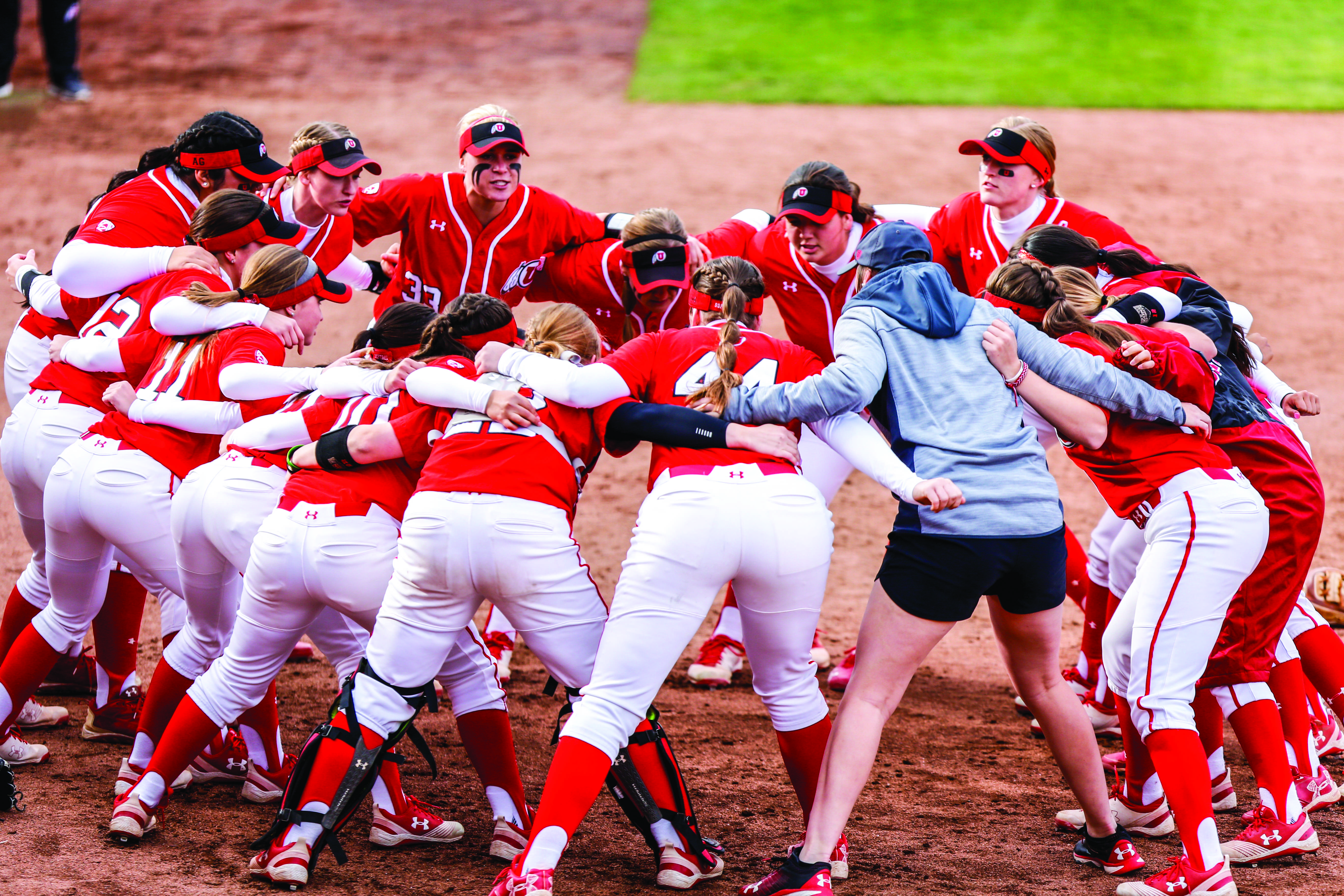 The University of Utah Softball Team huddle up prior to the start during an NCAA Softball game vs the BYU Cougars at Dumke Family Softball Stadium in Salt Lake City, UT on Wednesday April 18, 2018.  (Photo by Curtis Lin | Daily Utah Chronicle)