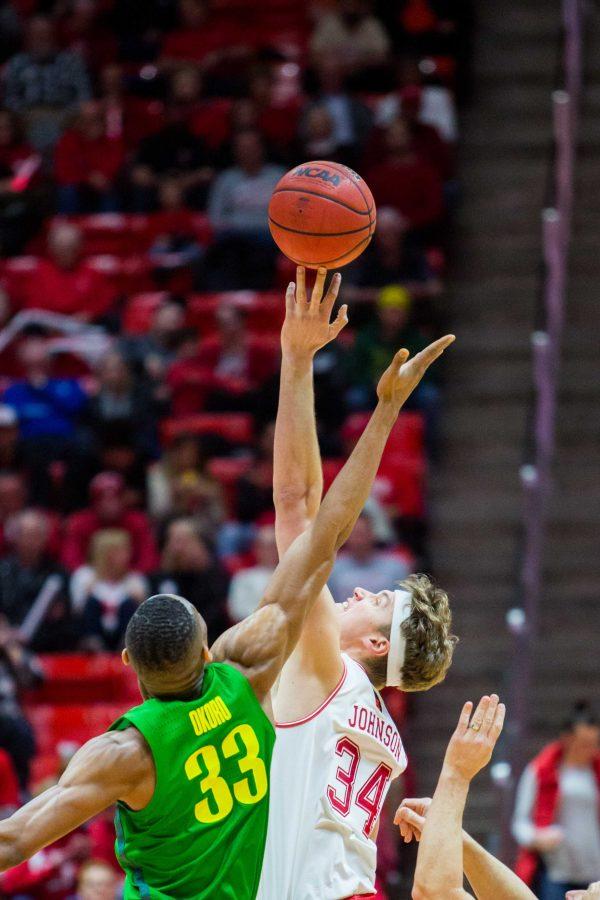 University of Utah junior forward Jayce Johnson (34) tipped the ball towards Utah teammates in an NCAA Men's Basketball game vs. the University of Oregon at Jon M. Huntsman Center in Salt Lake City, UT on Thursday January 31, 2019.  (Photo by Curtis Lin | Daily Utah Chronicle)