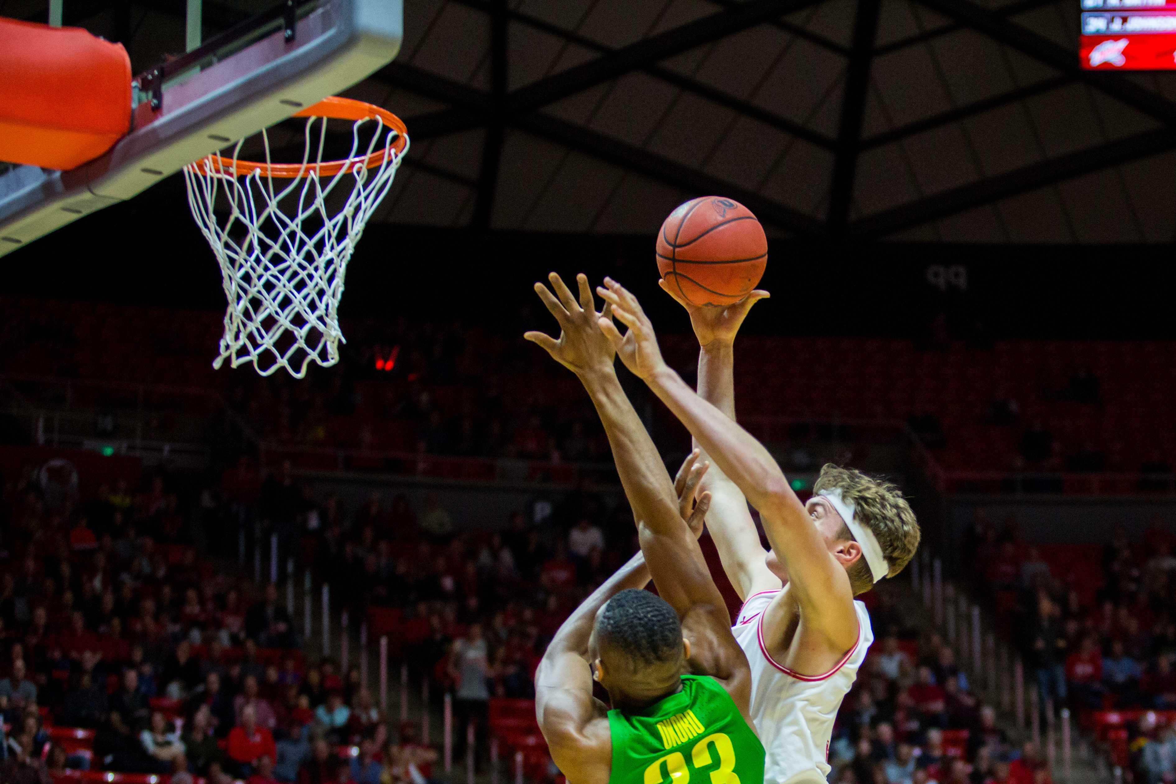 University of Utah junior forward Jayce Johnson (34) scored over an Oregon defender in an NCAA Men's Basketball game vs. the University of Oregon at Jon M. Huntsman Center in Salt Lake City, UT on Thursday January 31, 2019.  (Photo by Curtis Lin | Daily Utah Chronicle)