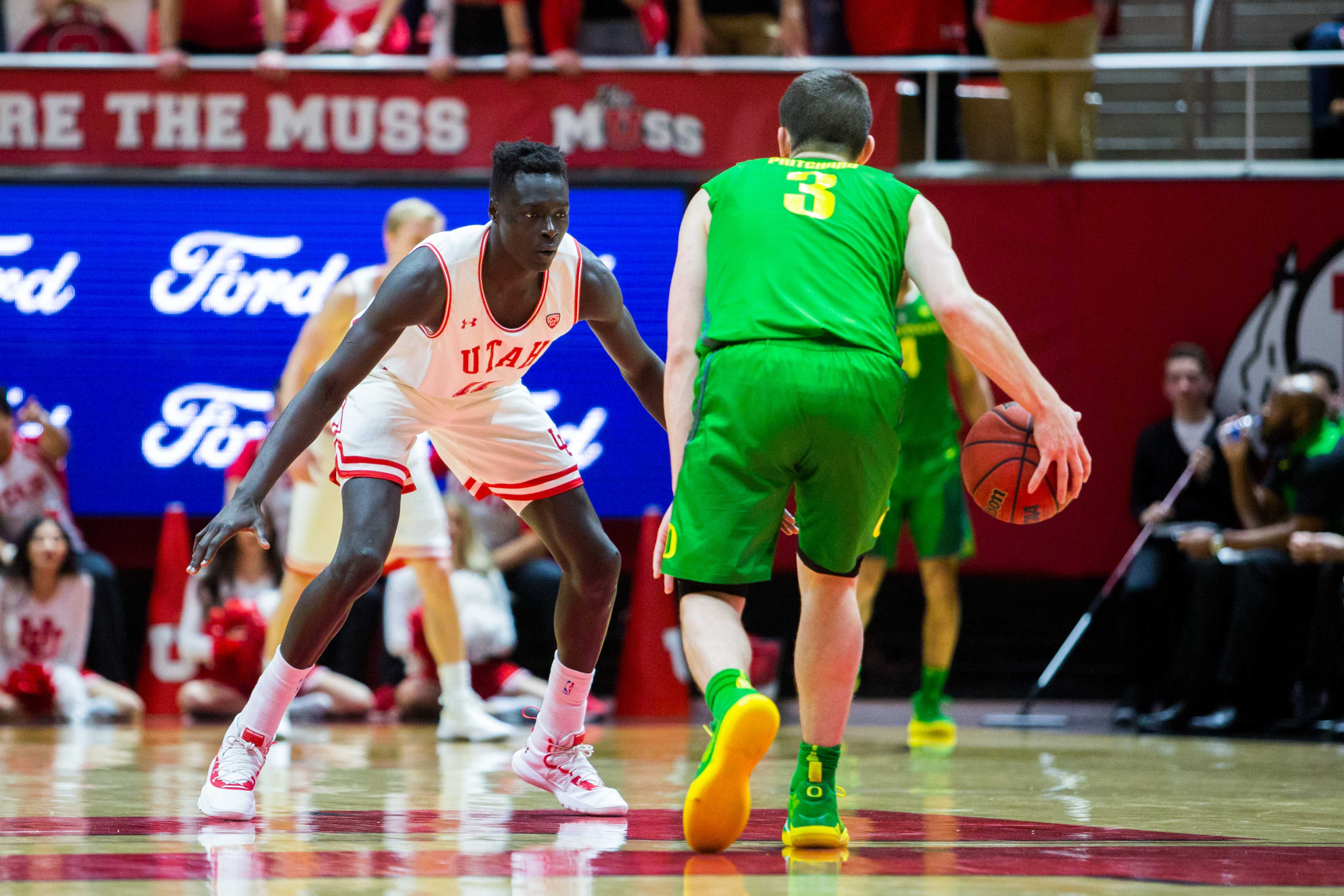 University of Utah freshman forward Both Gach (11) spread his arms to defend against the Oregon Ducks in an NCAA Men's Basketball game vs. the University of Oregon at Jon M. Huntsman Center in Salt Lake City, UT on Thursday January 31, 2019.  (Photo by Curtis Lin | Daily Utah Chronicle)