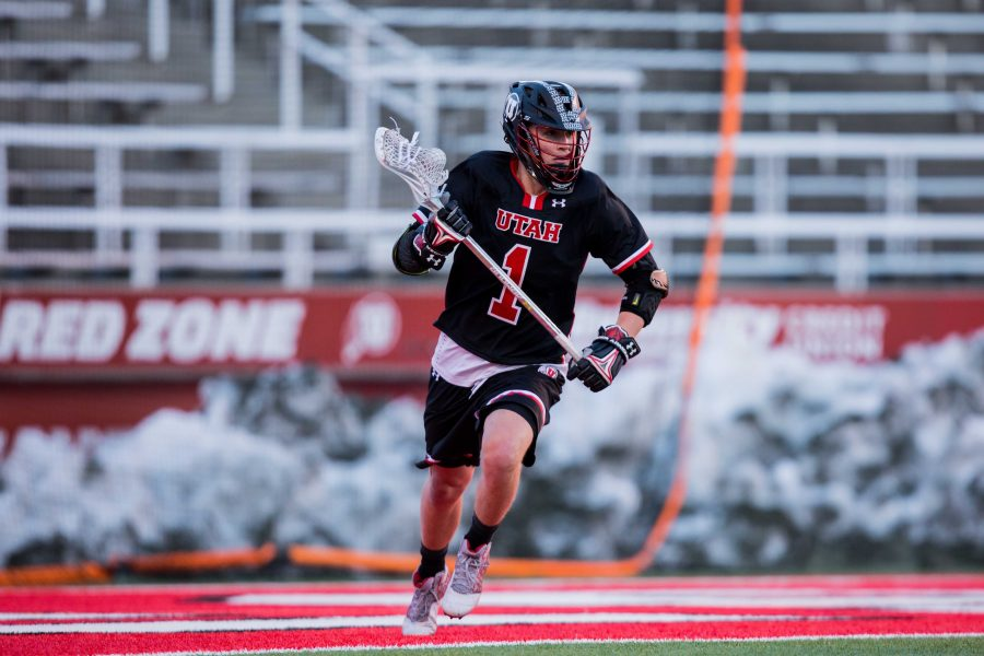 University of Utah sophomore attacker Josh Stout (1) looked to pass to a teammate in an NCAA Men's Lacrosse game vs. Vermont at Rice-Eccles Stadium in Salt Lake City, UT on Friday February 01, 2019.  (Photo by Curtis Lin | Daily Utah Chronicle)