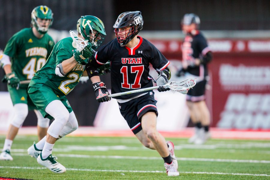 University of Utah freshman attacker Jake Canton (17) looked to pass to a teammate in an NCAA Men's Lacrosse game vs. Vermont at Rice-Eccles Stadium in Salt Lake City, UT on Friday February 01, 2019.  (Photo by Curtis Lin | Daily Utah Chronicle)
