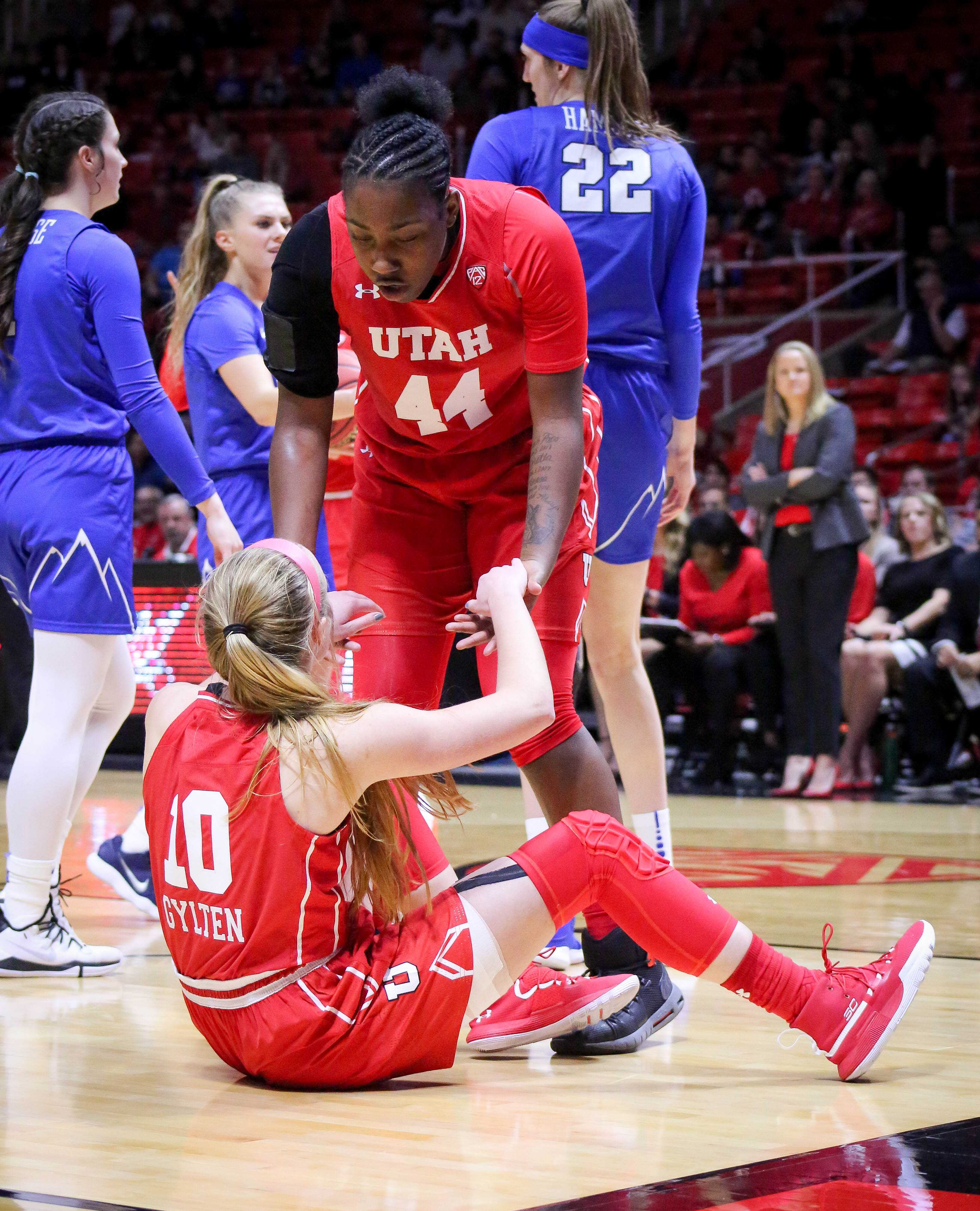 DRE'UNA EDWARDS (44) helps teammate DRU GYLTEN (10) as The University of Utah Lady Utes take on Brigham Young University at the Huntsman Center in Salt Lake City, UT on Saturaday, Dec. 8, 2018 (Photo by Cassandra Palor | Daily Utah Chronicle)
