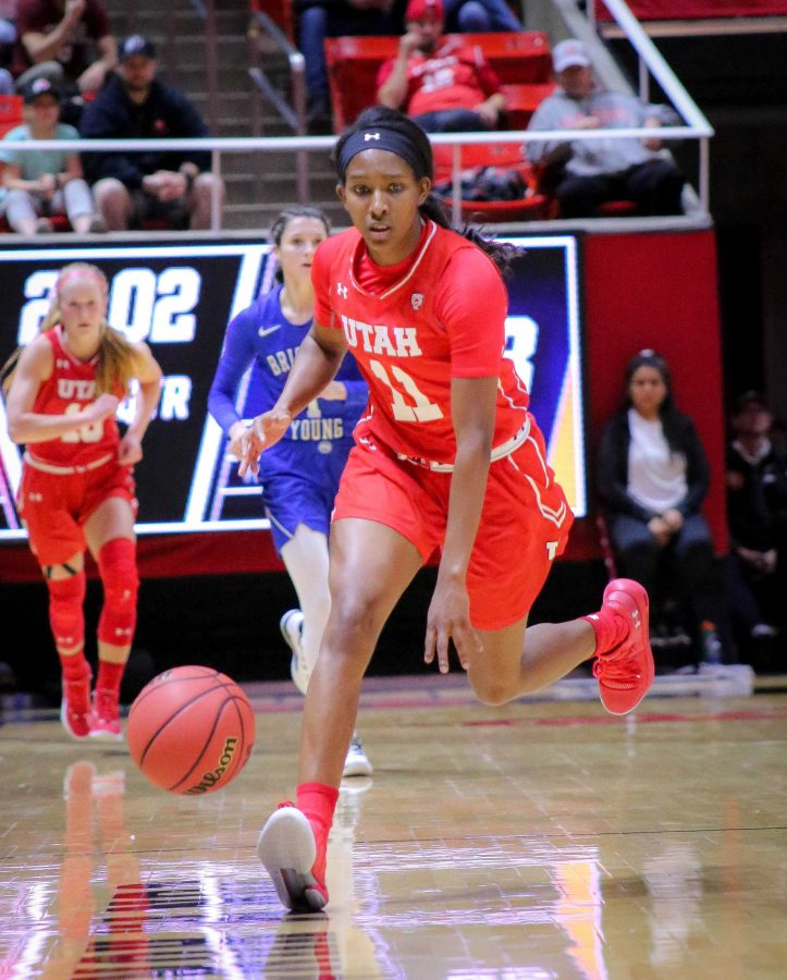 ERIKA BEAN (11) dribbles down the court as The University of Utah Lady Utes take on Brigham Young University at the Huntsman Center in Salt Lake City, UT on Saturaday, Dec. 8, 2018 (Photo by Cassandra Palor | Daily Utah Chronicle)