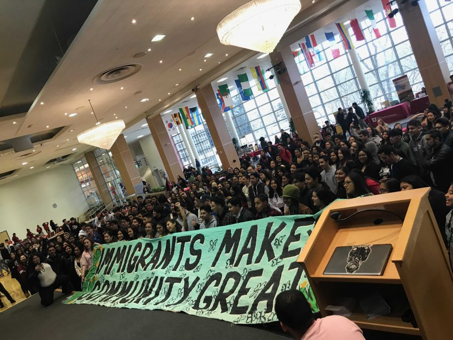 High+school+students+at+2019+MEChA+Conference+at+the+U+on+Feb+27%2C+2019+next+to+a+banner+that+reads%3A+IMMIGRANTS+MAKE+COMMUNITY+GREAT+%28Photo+by+Katelyn+Collett%29