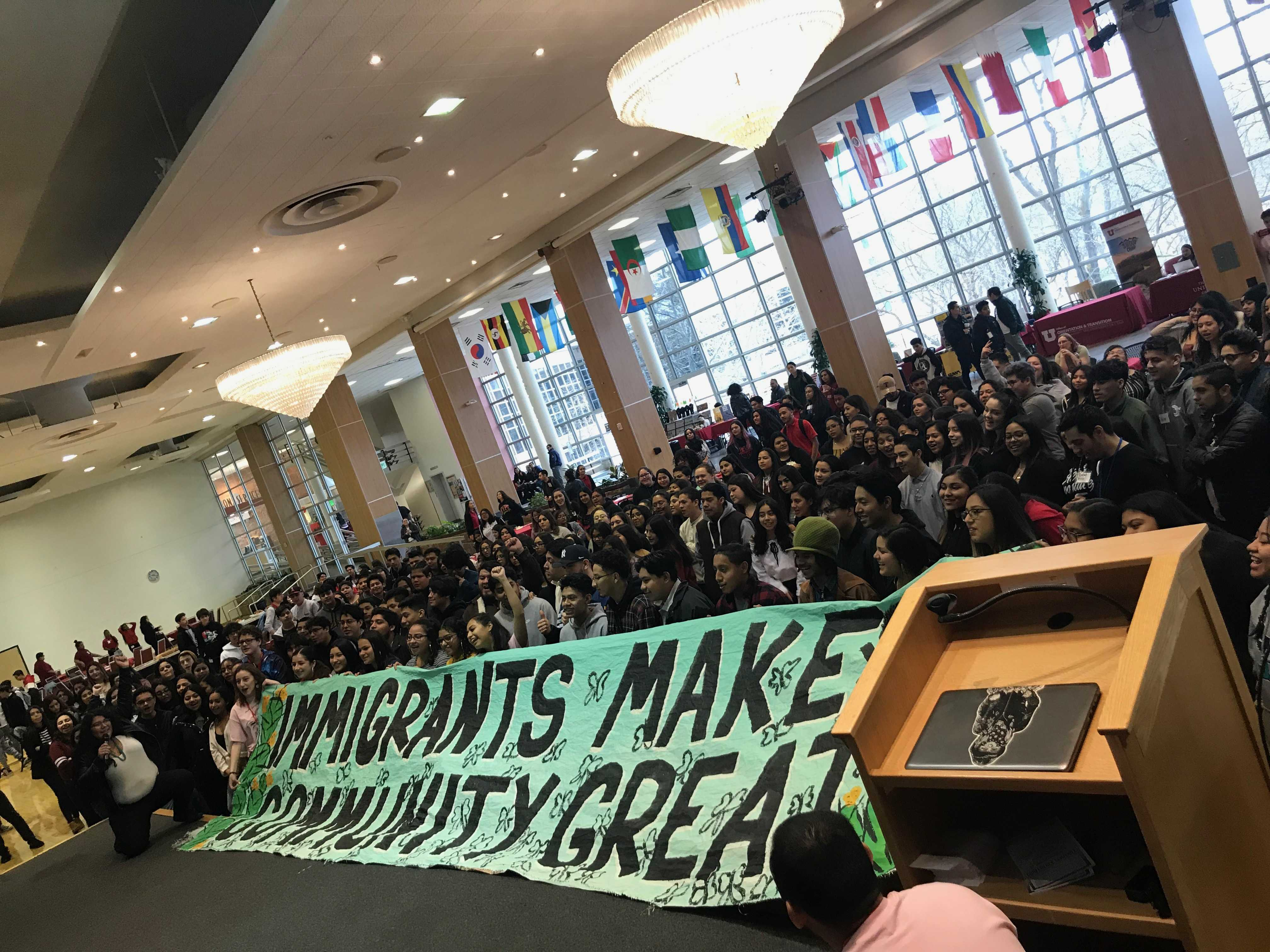 High school students at 2019 MEChA Conference at the U on Feb 27, 2019 next to a banner that reads: