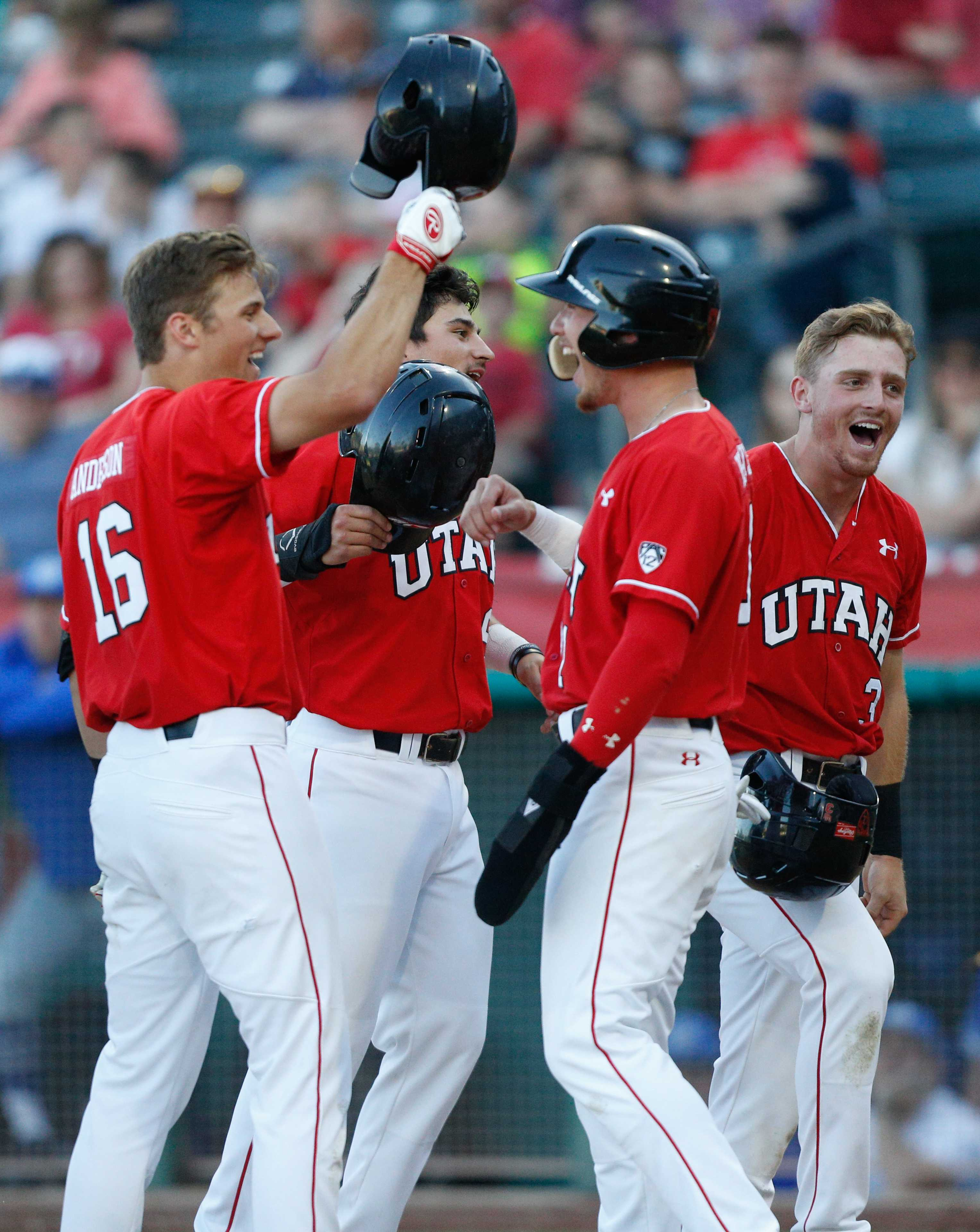 DeShawn Keirsey (9), Oliver Dunn (3) and Ryyker Tom (21) celebrate at home plate with Chandler Anderson (16) after Anderson hit a grand slam as theUtes take on the BYU Cougars at Smith's Ballpark May 8, 2018.  (Photo by: Justin Prather / Daily Utah Chronicle).