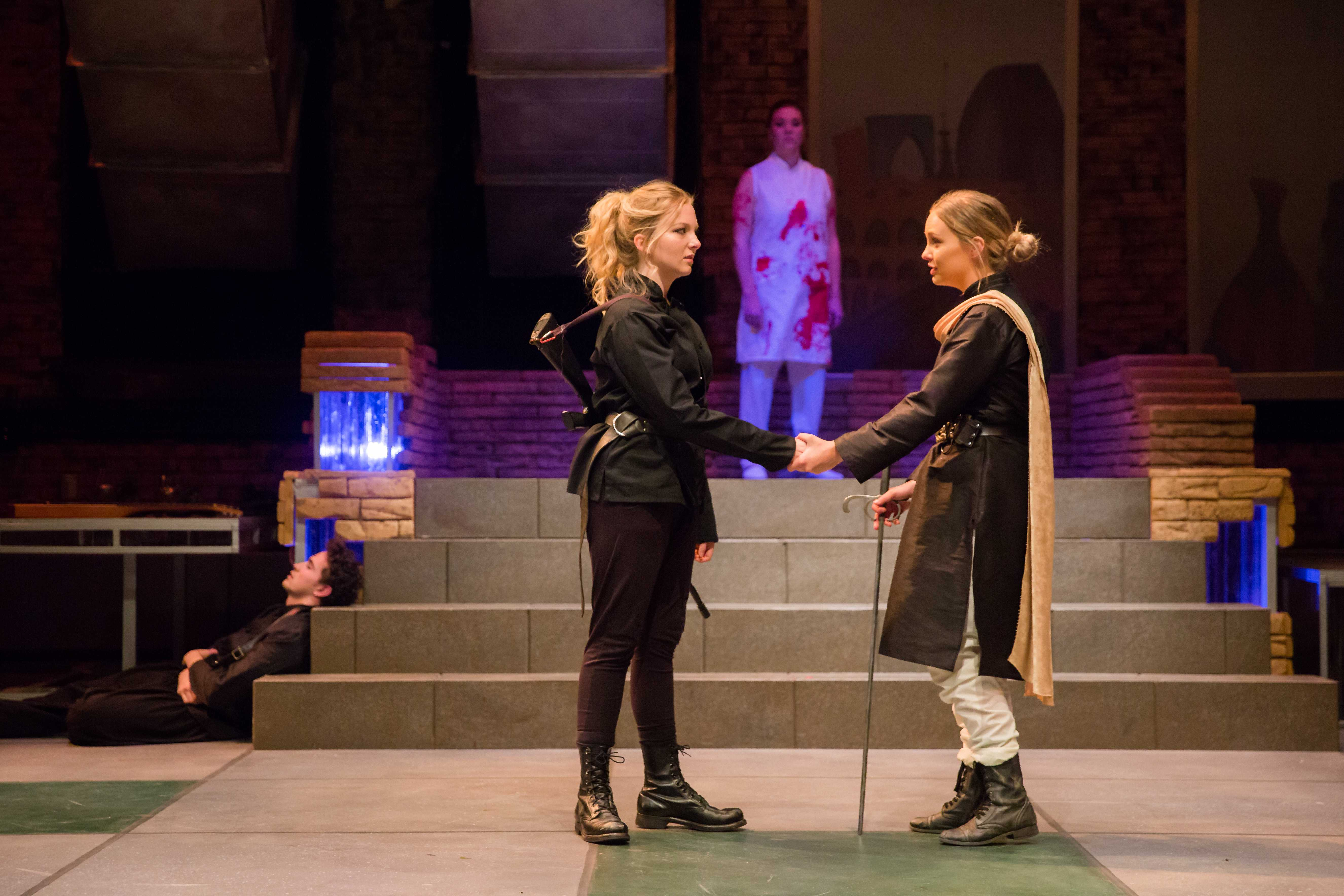 Selah McKenna (left) and Lindsie Kongsore (right) in the University of Utah's production of Julius Caesar (Photo by Todd Collins)
