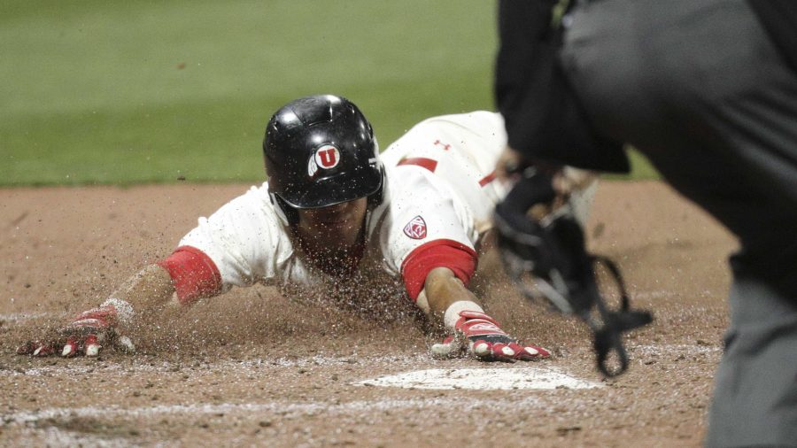 Utes infielder Dallas Carroll (23) scores from Dominic Foscalina's sacrifice fly in the bottom of the fifth to make the score 7-4  against BYU at Smiths Ballpark on Tuesday, March 28, 2017. (Chris Ayers|Daily Utah Chronicle.)