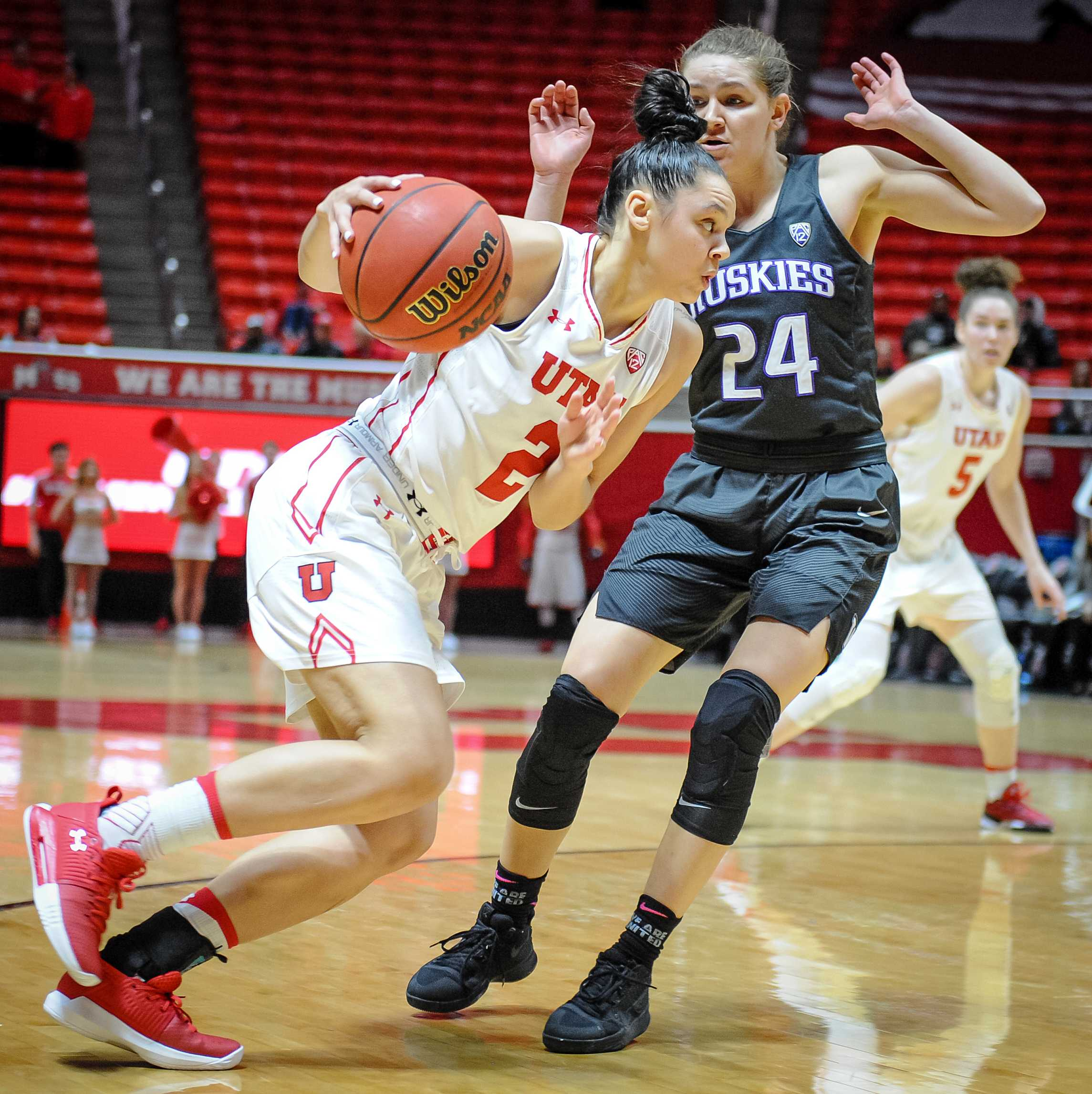 Utah Utes guard Tori Williams (2) drives past Washington Huskies guard Jenna Moser (24) as the Lady Utes take on the Lady Huskies from the University of Washington at the Huntsman Center in Salt Lake City, UT on Sunday, Feb. 18, 2018  (Photo by Adam Fondren | Daily Utah Chronicle)