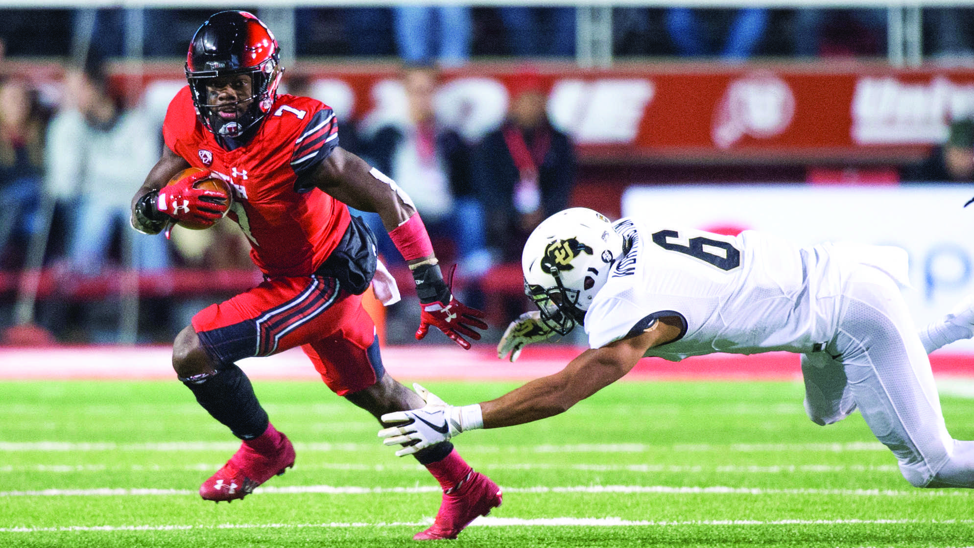 University of Utah sophomore running back Devonta'e Henry-Cole (7) evades University of Colorado junior defensive back Evan Worthington (6) in an NCAA Football game at Rice Eccles Stadium in Salt Lake City, Utah on Saturday, Nov. 25, 2017  (Photo by Kiffer Creveling | The Daily Utah Chronicle)