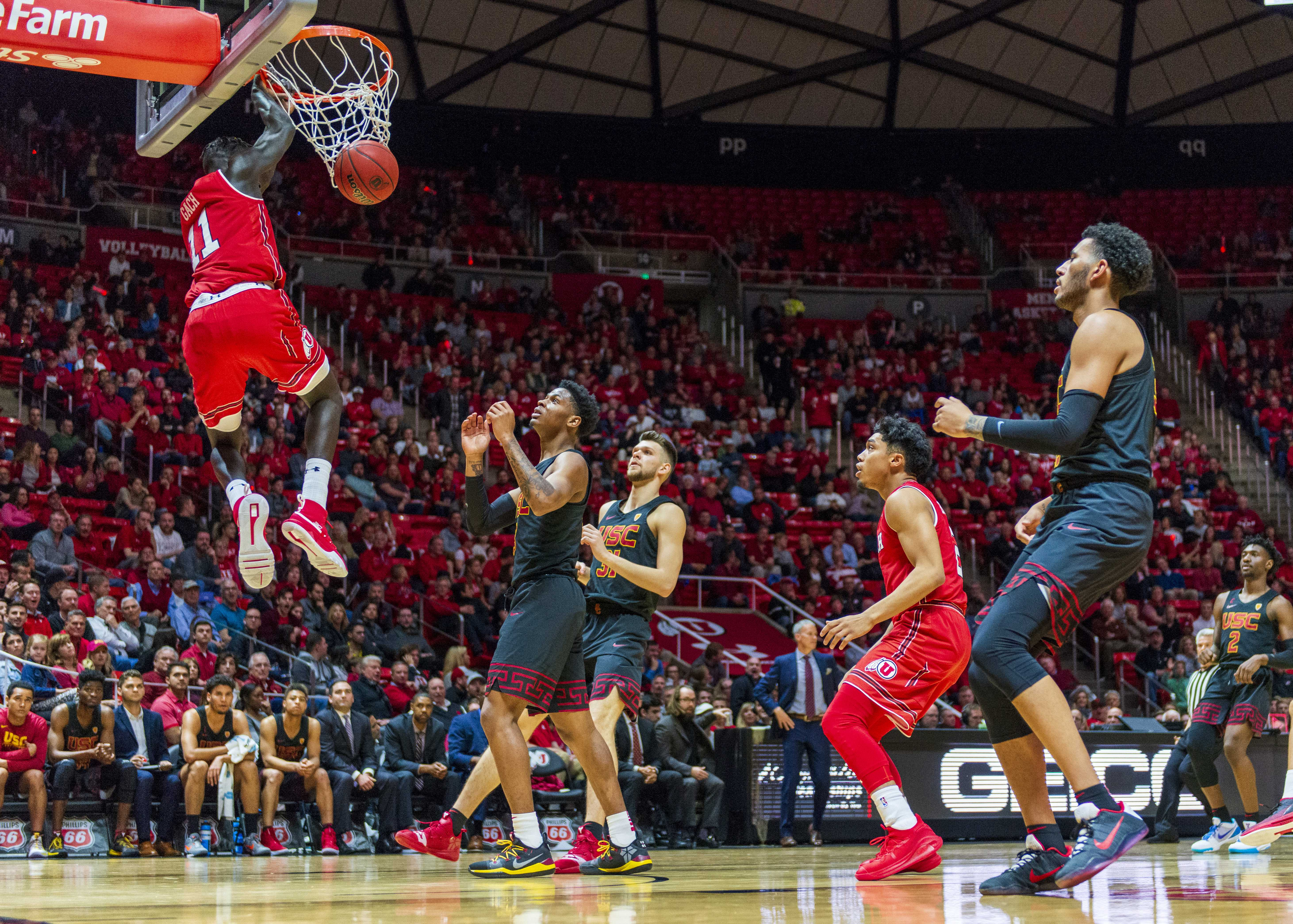 University of Utah freshman forward Both Gach (11) makes a slam dunk during an NCAA Basketball game vs. the USC Trojans at the Jon M. Huntsman Center in Salt Lake City, Utah on Thursday, March 7, 2019. (Photo by Kiffer Creveling | The Daily Utah Chronicle)