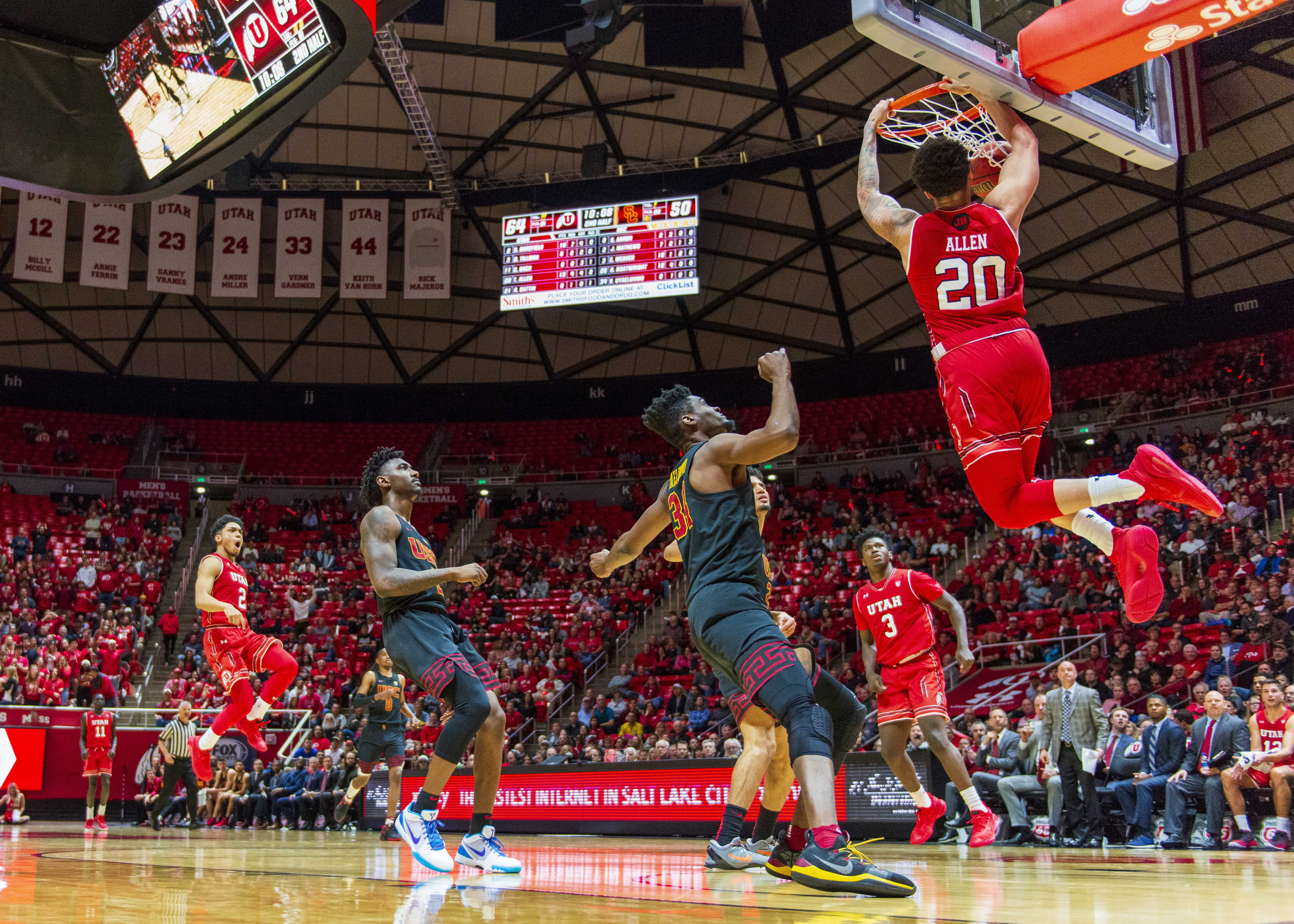 University of Utah freshman forward Timmy Allen (20) makes a slam dunk during an NCAA Basketball game vs. the USC Trojans at the Jon M. Huntsman Center in Salt Lake City, Utah on Thursday, March 7, 2019. (Photo by Kiffer Creveling | The Daily Utah Chronicle)